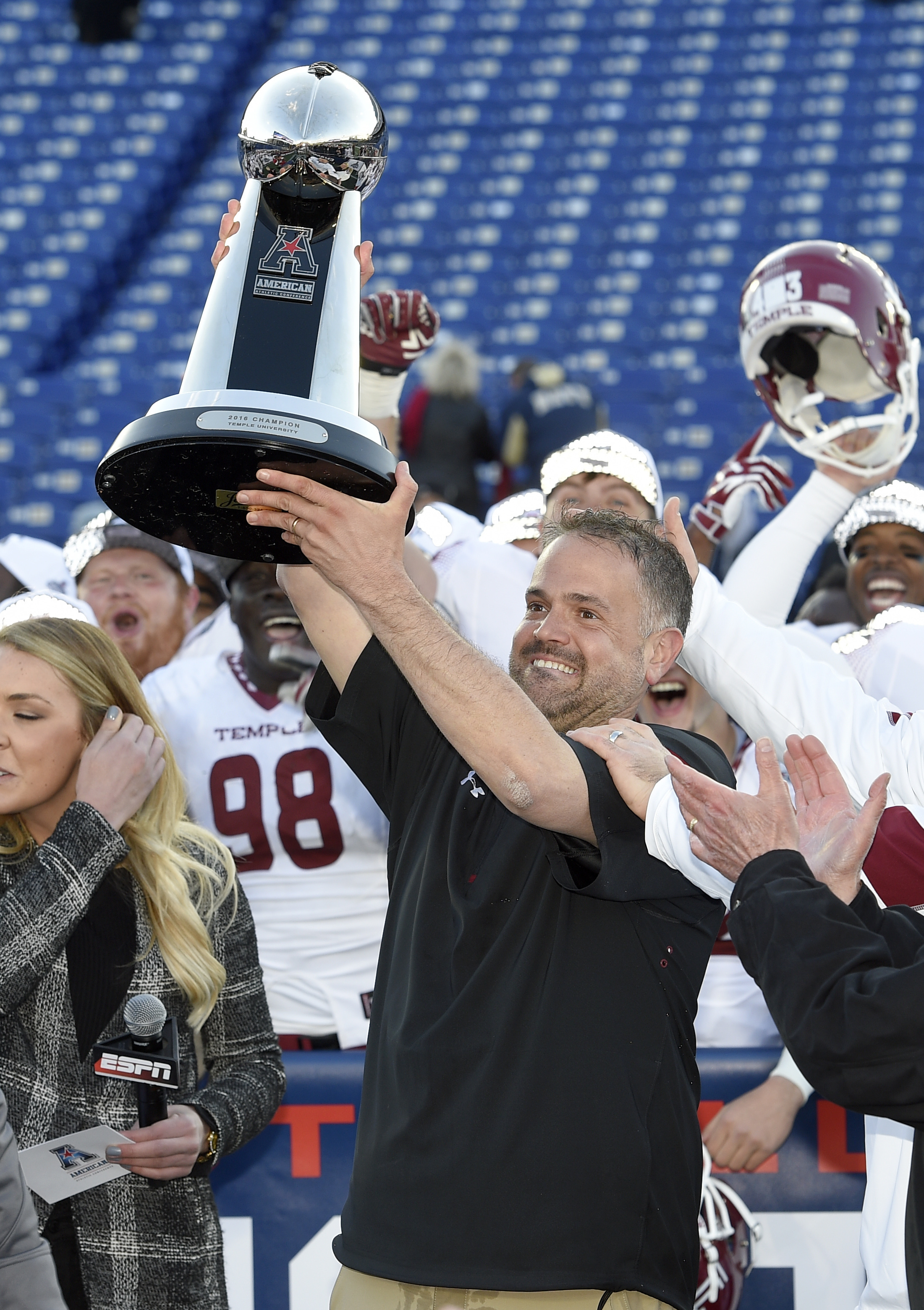 Temple head coach Matt Rhule poses with the trophy after after they defeated Navy 34-10 in the American Athletic Conference championship NCAA college football game, Saturday, Dec. 3, 2016, in Annapolis, Md.AP Photo/Nick Wass)