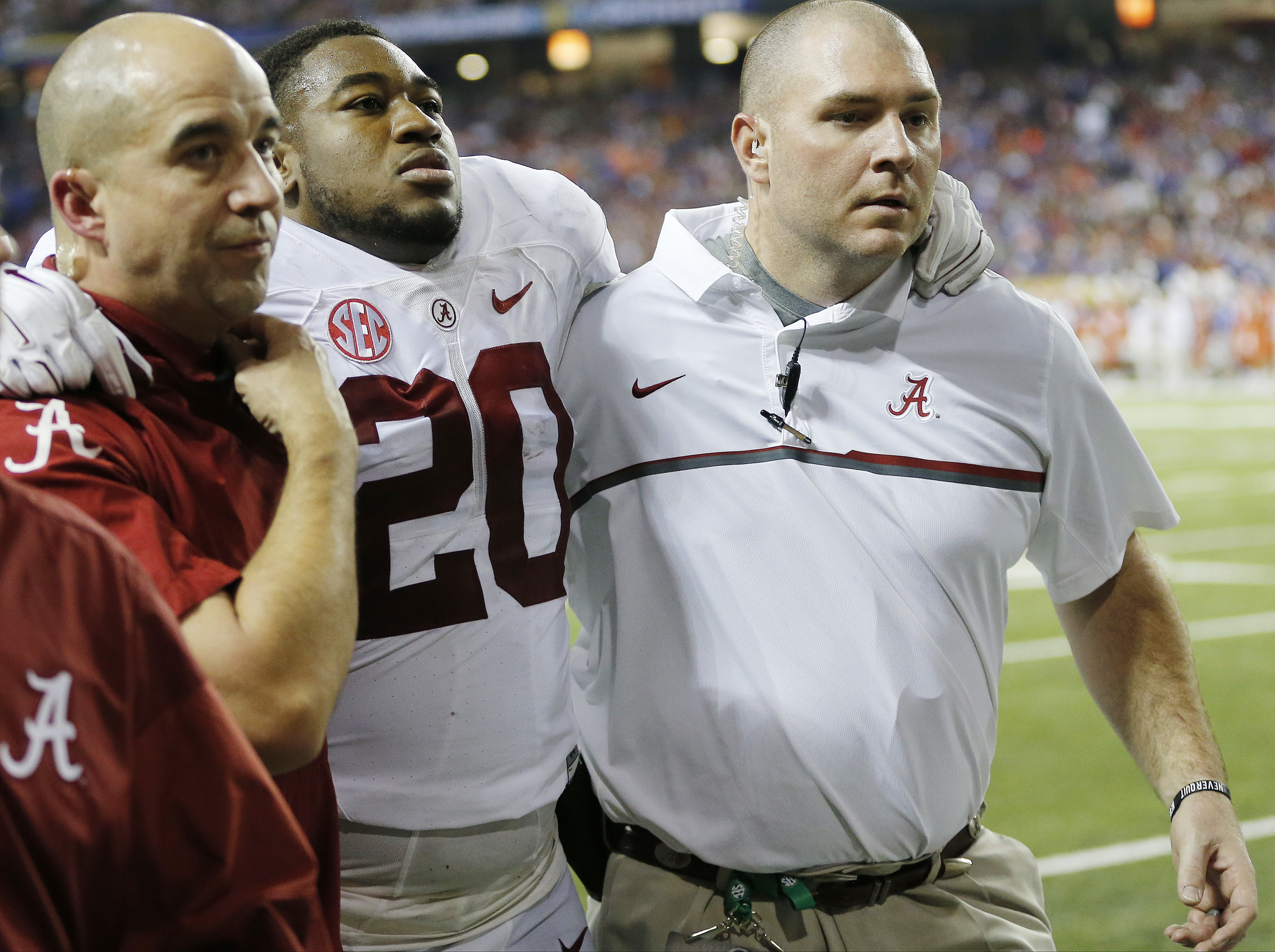 Alabama linebacker Shaun Dion Hamilton (20) is helped off the field due to injury against Florida during the second half of the Southeastern Conference championship NCAA college football game, Saturday, Dec. 3, 2016, in Atlanta.(AP Photo/John Bazemore)