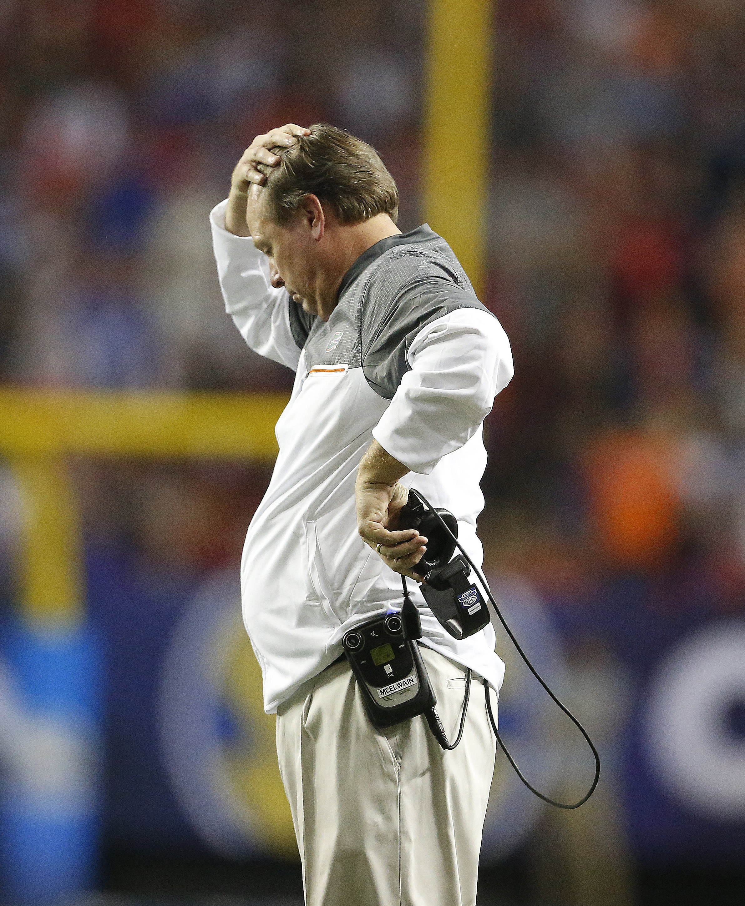 Florida head coach Jim McElwain reacts to play against Alabama during the second half of the Southeastern Conference championship NCAA college football game, Saturday, Dec. 3, 2016, in Atlanta. Alabama won 54-16. (AP Photo/Butch Dill)