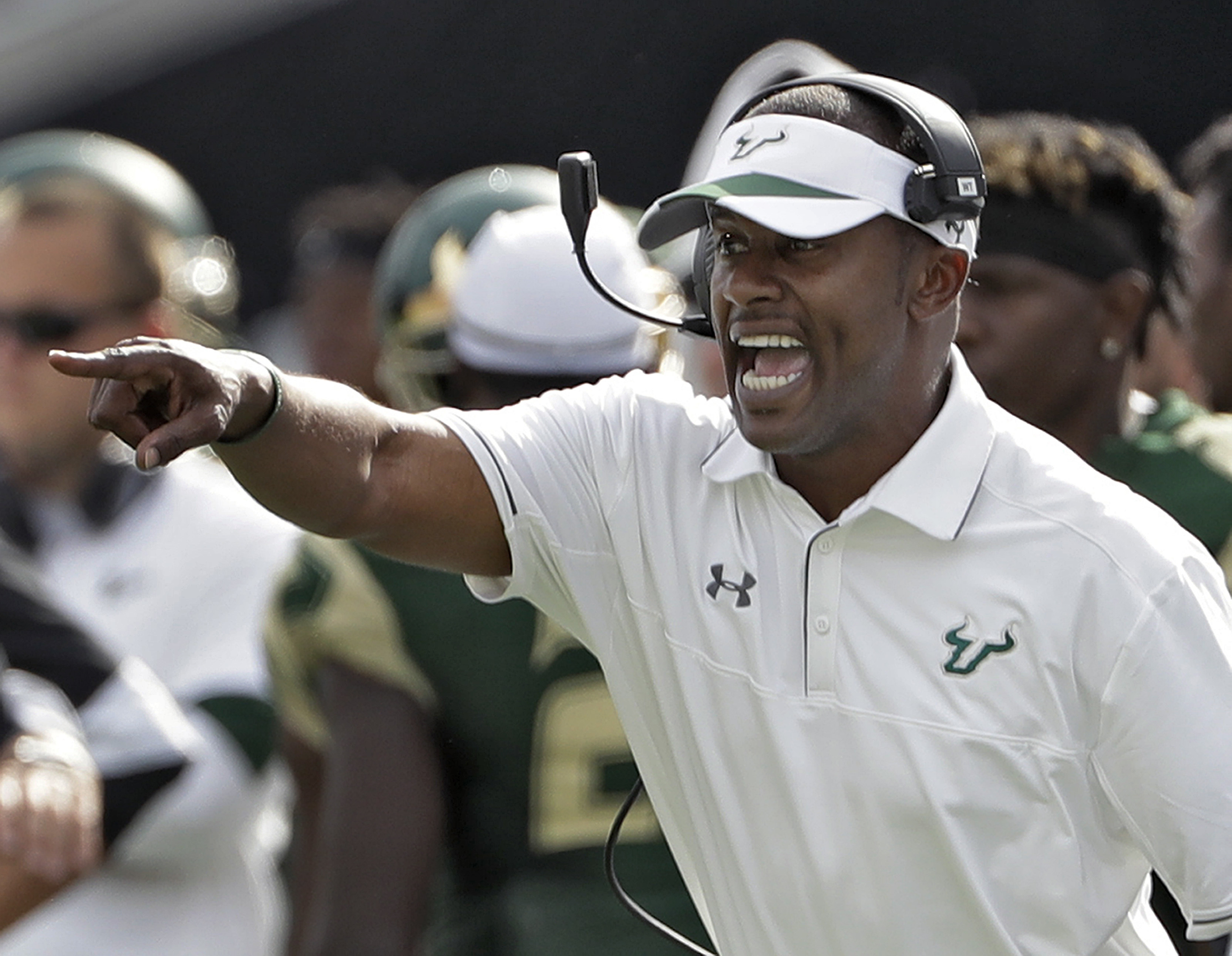 South Florida head coach Willie Taggart shouts instructions to the team during the third quarter of an NCAA college football game against Central Florida, Saturday, Nov. 26, 2016, in Tampa, Fla. South Florida won 48-31. (AP Photo/Chris O'Meara)