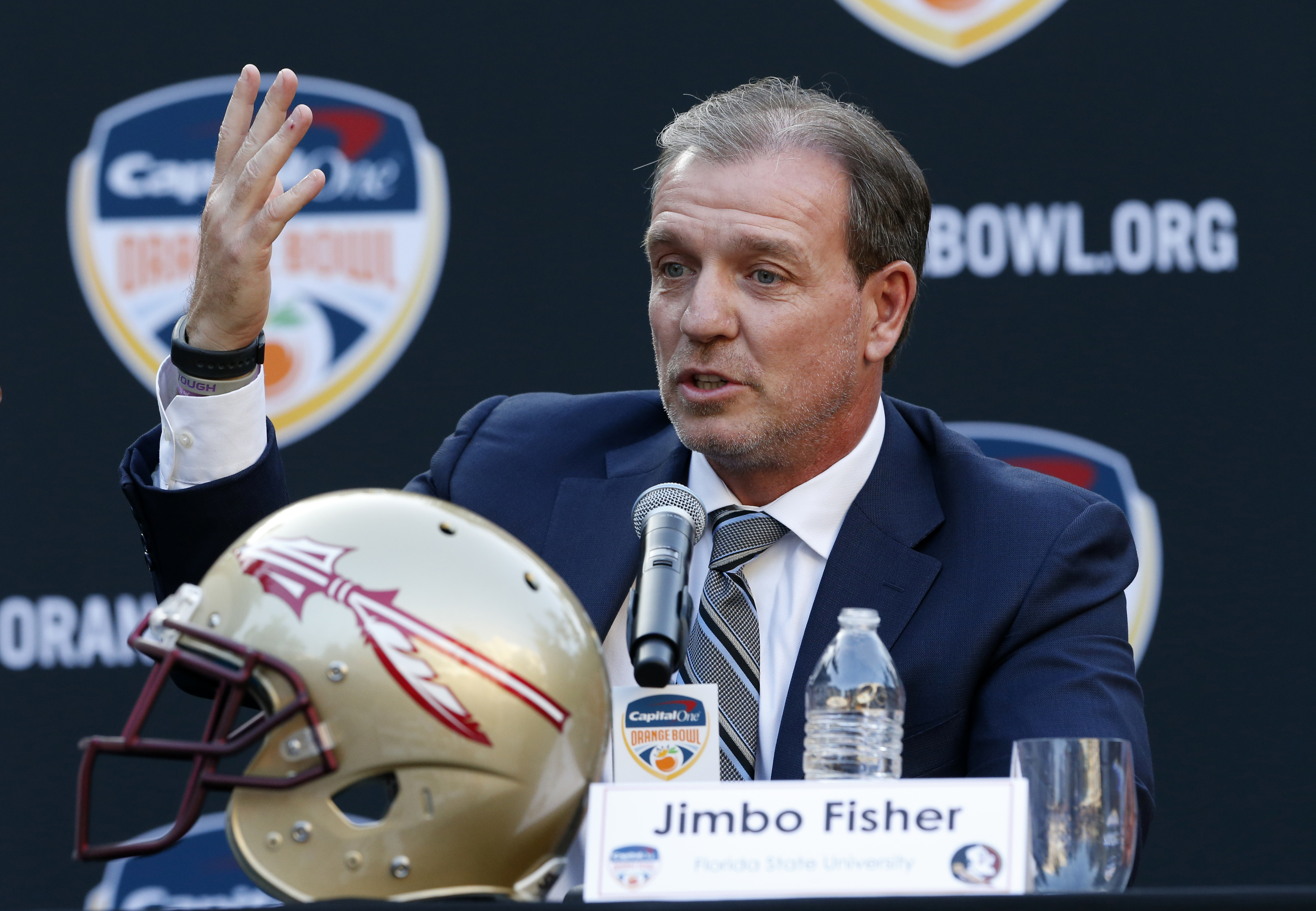 Florida State head coach Jimbo Fisher gestures as he speaks during a news conference, Wednesday, Dec. 7, 2016 in Hollywood, Fla. Michigan and Florida State will play each other Dec. 30, during the Orange Bowl in Miami Gardens, Fla. Fisher and Michigan coa