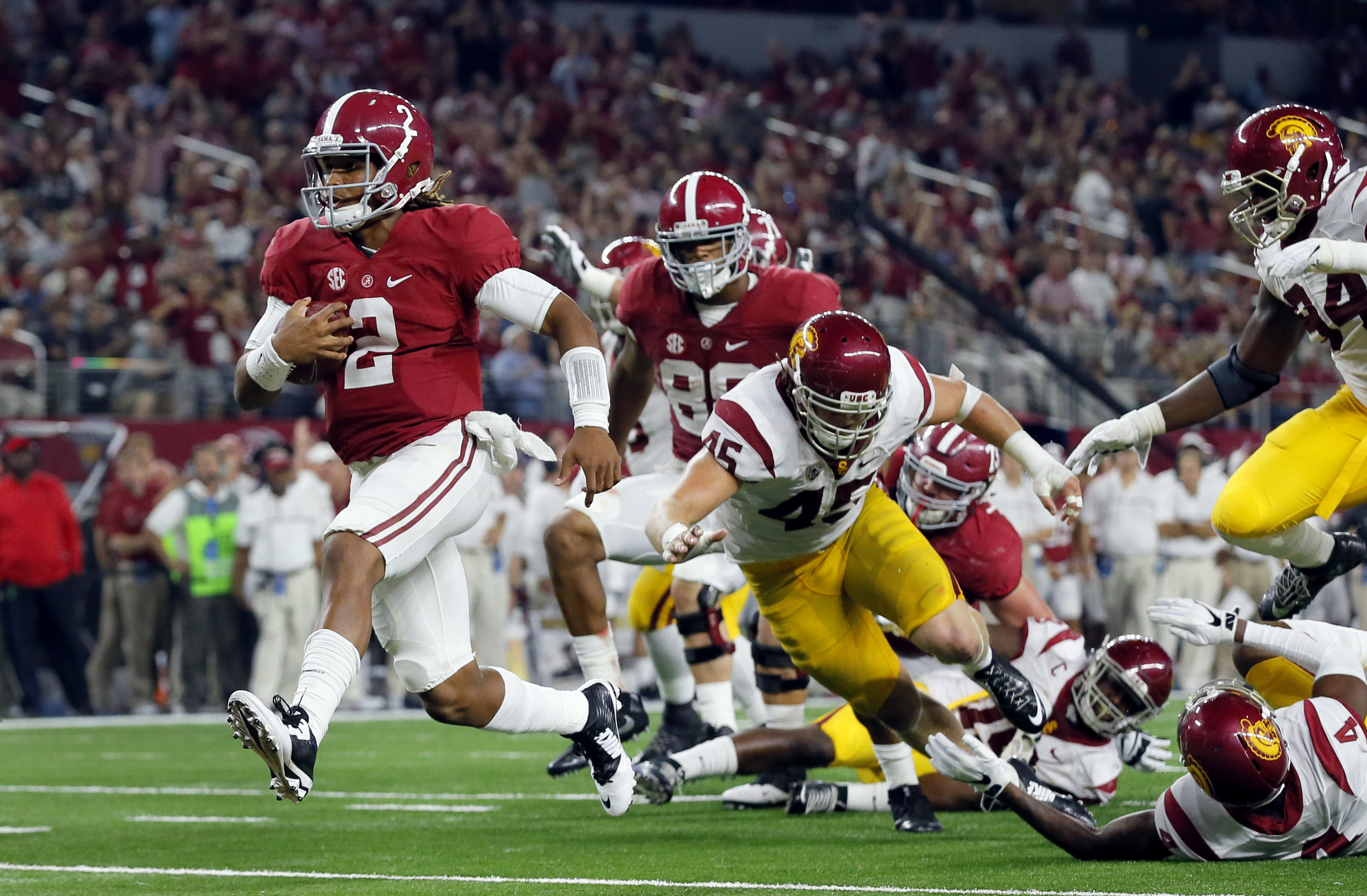 FILE - In this Sept. 3, 2016, file photo, Alabama quarterback Jalen Hurts slips into the end zone on a 7-yard touchdown run during the second half of an NCAA college football game against Southern California, in Arlington, Texas. Freshman Jalen Hurts was