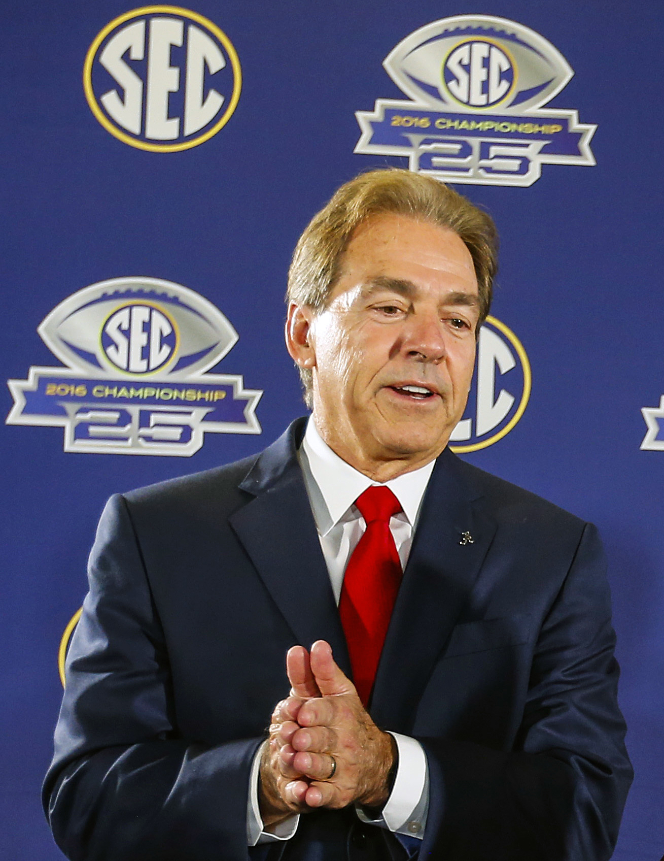 FILE - In this Dec. 2, 2016, file photo, Alabama head coach Nick Saban speaks during a press conference ahead of the Southeastern Conference Championship NCAA college football game against Florida, in Atlanta. Saban is the choice for coach of the year of