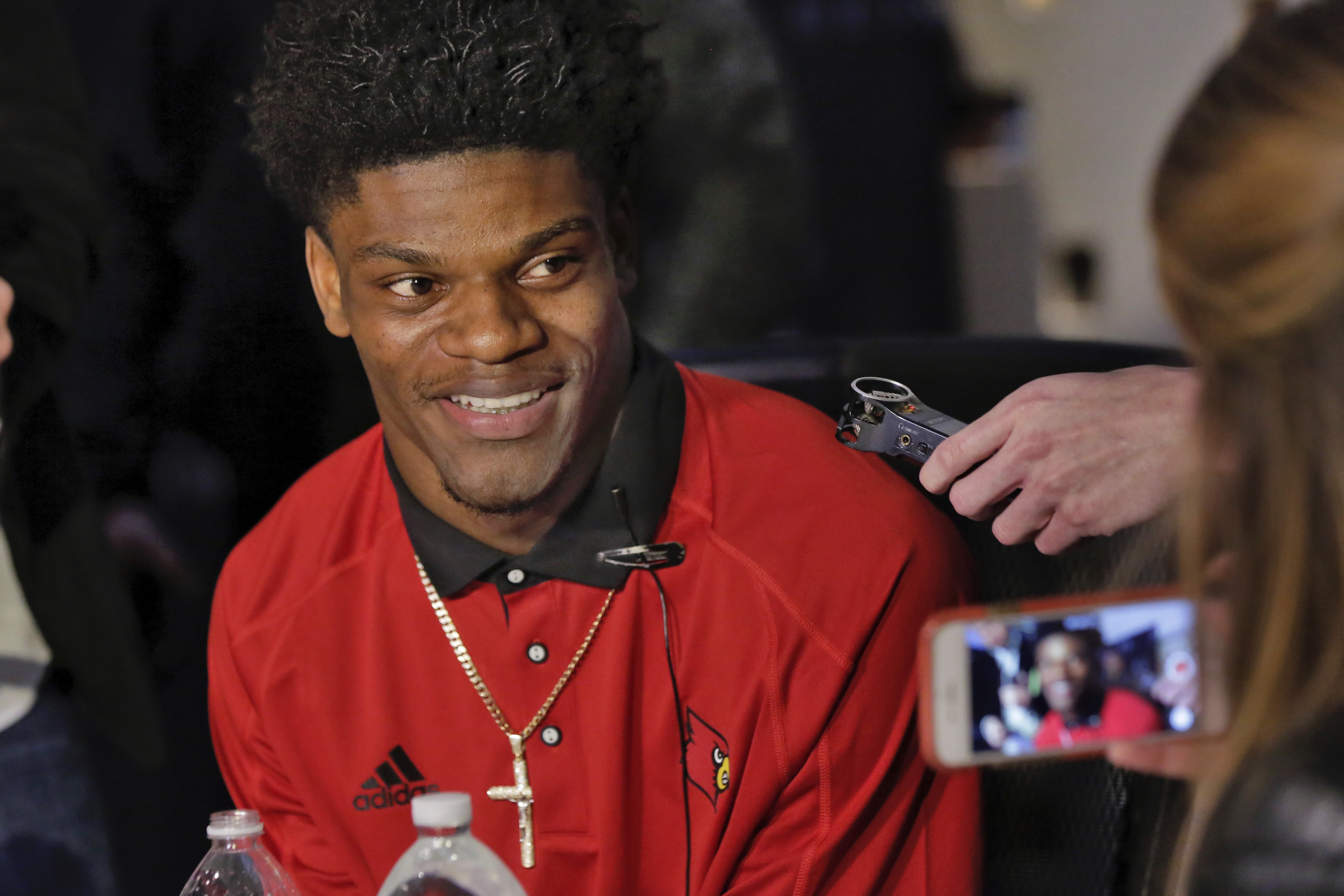 University of Louisville quarterback Lamar Jackson is interviewed during a Heisman Trophy media event in New York, Friday, Dec. 9, 2016. (AP Photo/Richard Drew)