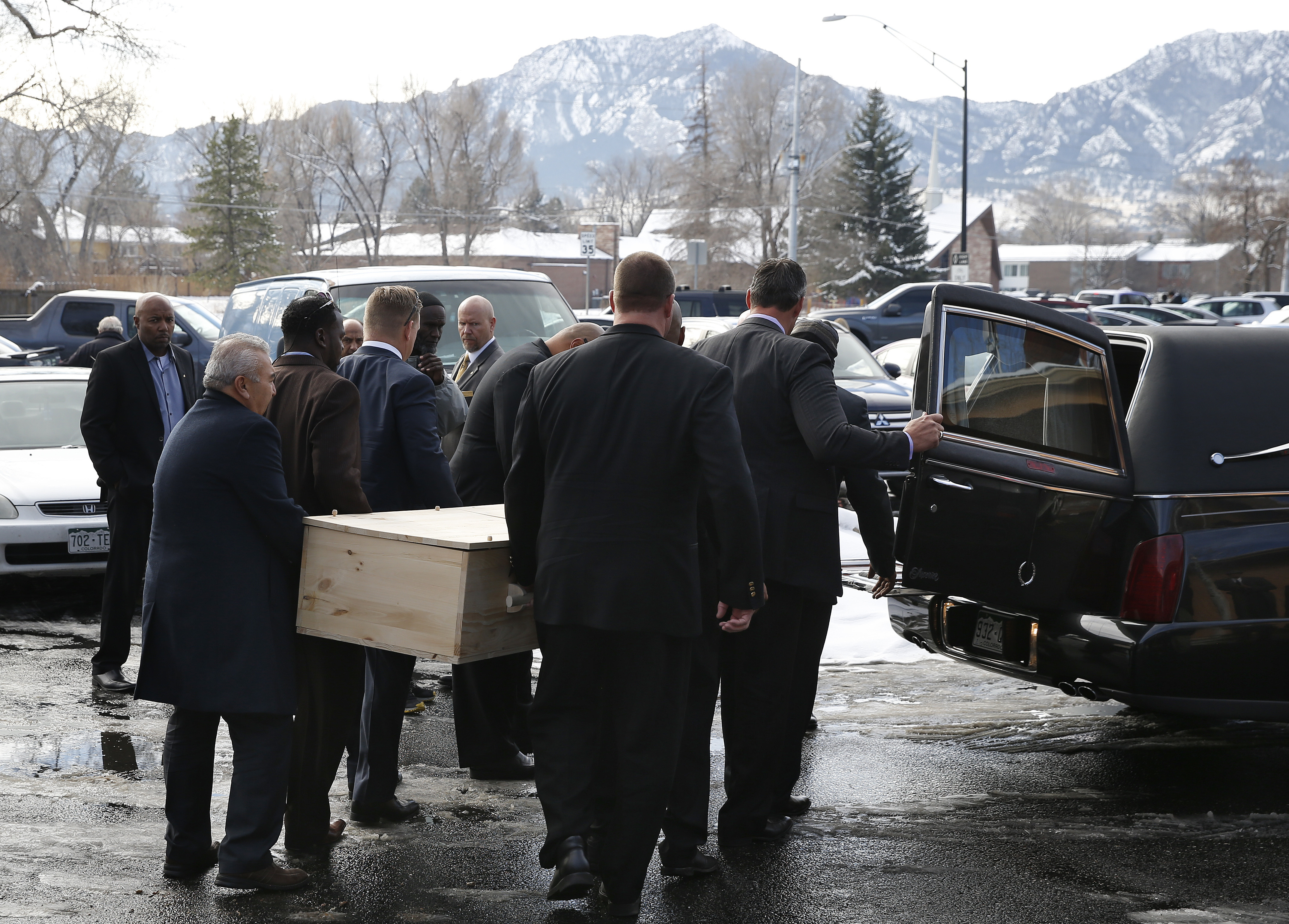 Pallbearers carry the casket for  late Heisman Trophy winner and former Colorado running back Rashaan Salaam, following his funeral at the Islamic Center of Boulder, Friday, Dec. 9, 2016, in  Boulder, Colo. Former teammates joined family and friends to sa