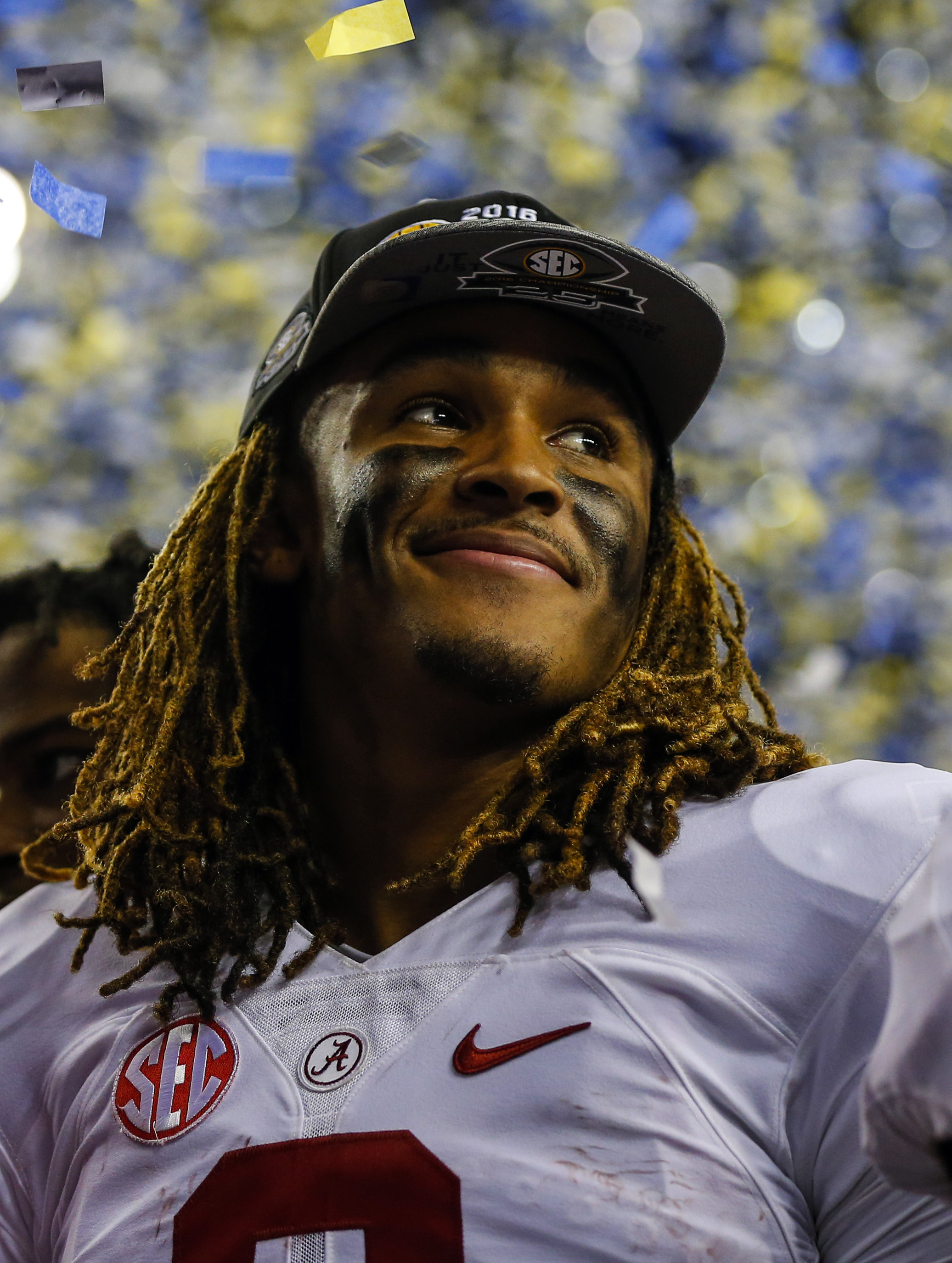 FILE - In this Dec. 3, 2016, file photo, Alabama quarterback Jalen Hurts (2) celebrates after defeating Florida in the Southeastern Conference championship NCAA college football game, in Atlanta .Its easy to appraise Jalen Hurts' numbers: The yards, the t