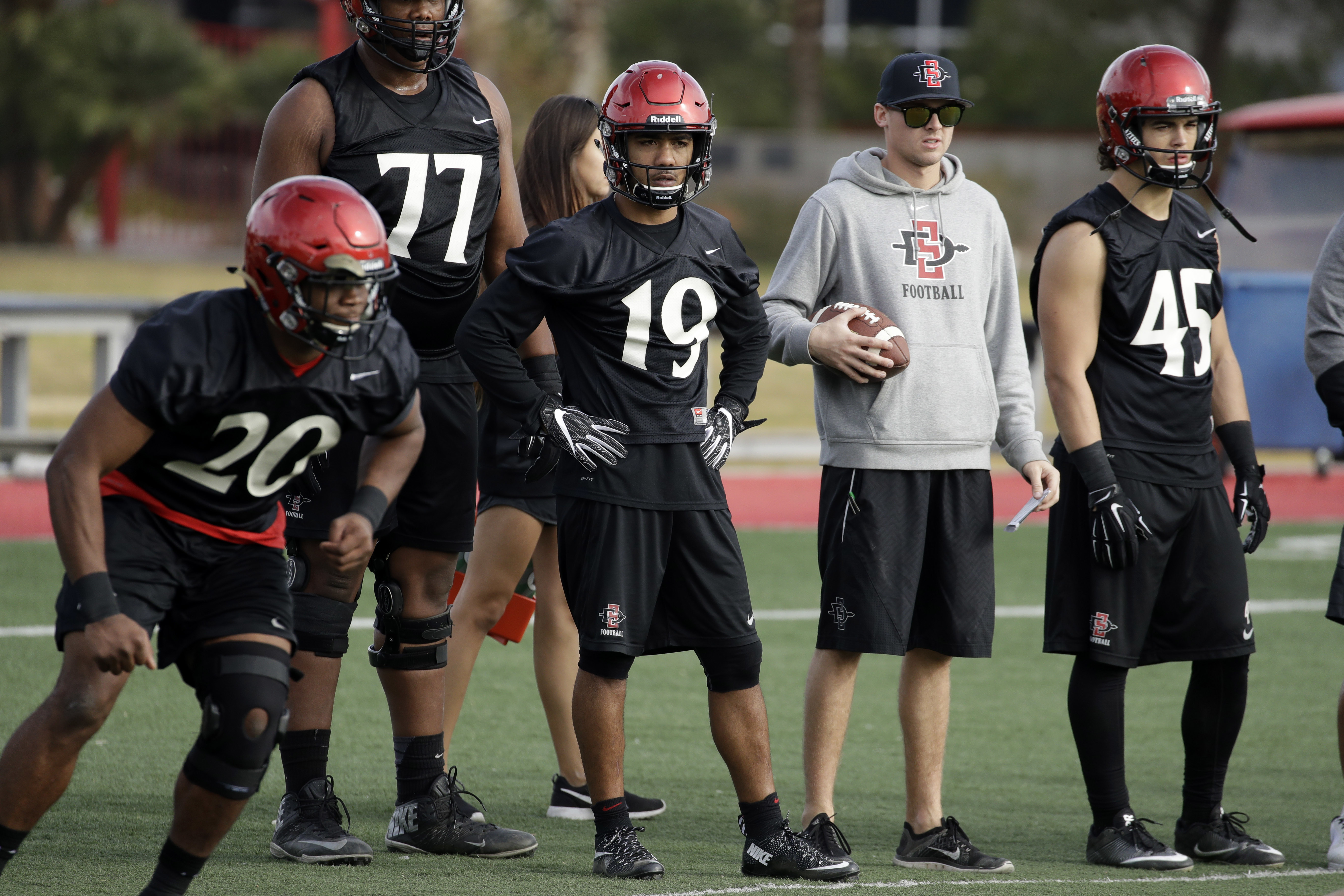 San Diego State's Donnel Pumphrey, center, watches practice Wednesday, Dec. 14, 2016, in Las Vegas. San Diego State is scheduled to play Houston Saturday in the Las Vegas Bowl. (AP Photo/John Locher)