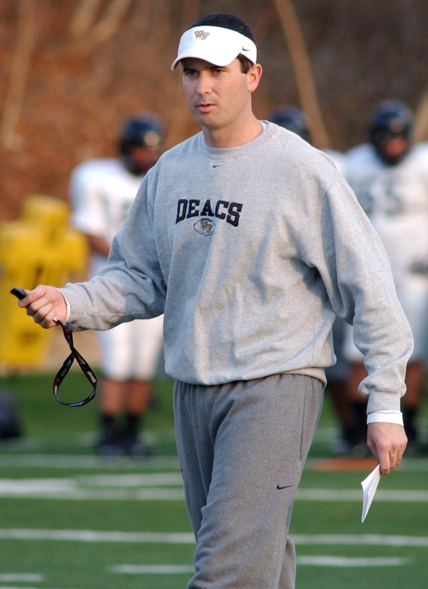 In this Dec. 9, 2006 file photo Tommy Elrod walks on the field while he was serving as assistant coach at Wake Forest University. Elrod, who has served as a radio announcer for the Deacons football games since 2014, has been identified by Wake Forest as t