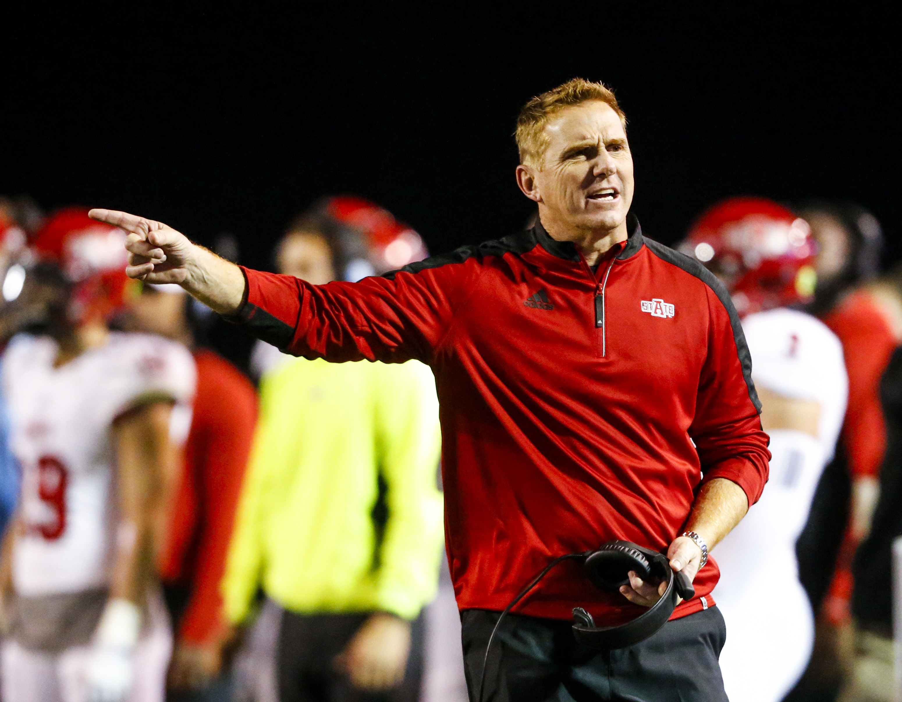 FILE - In this Nov. 17, 2016, file photo, Arkansas State coach Blake Anderson reacts to a call during the second half of the team's NCAA college football game against Troy, in Troy, Ala. Arkansas State and UCF certainly have a lot in common heading into S