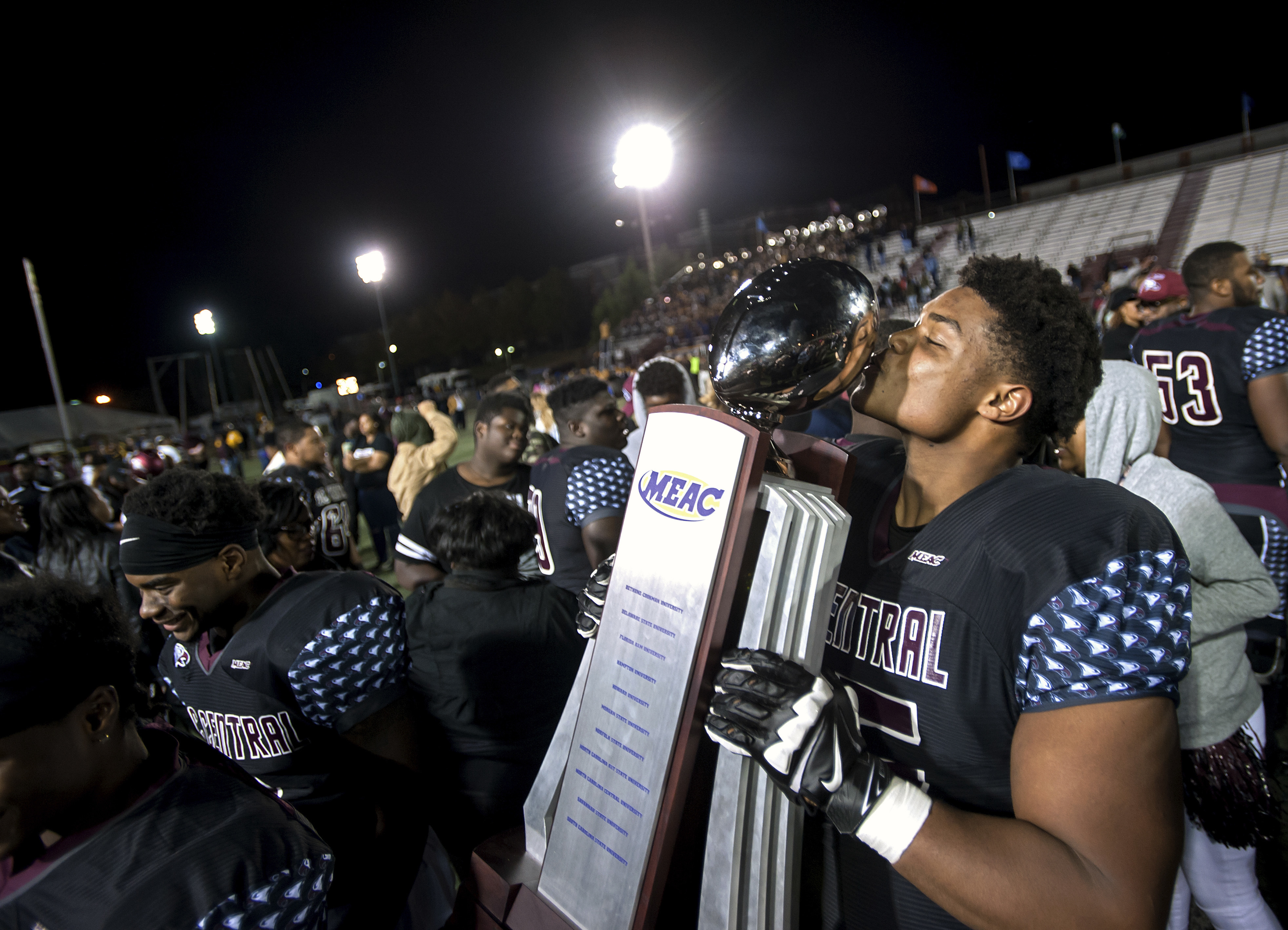 FILE - In this Nov. 19, 2016, file photo, North Carolina Central's Nick Leverett kisses the Mid-Eastern Athletic Conference (MEAC) championship trophy after the team's NCAA college football game against North Carolina A&T in Durham, N.C. North Carolina Ce