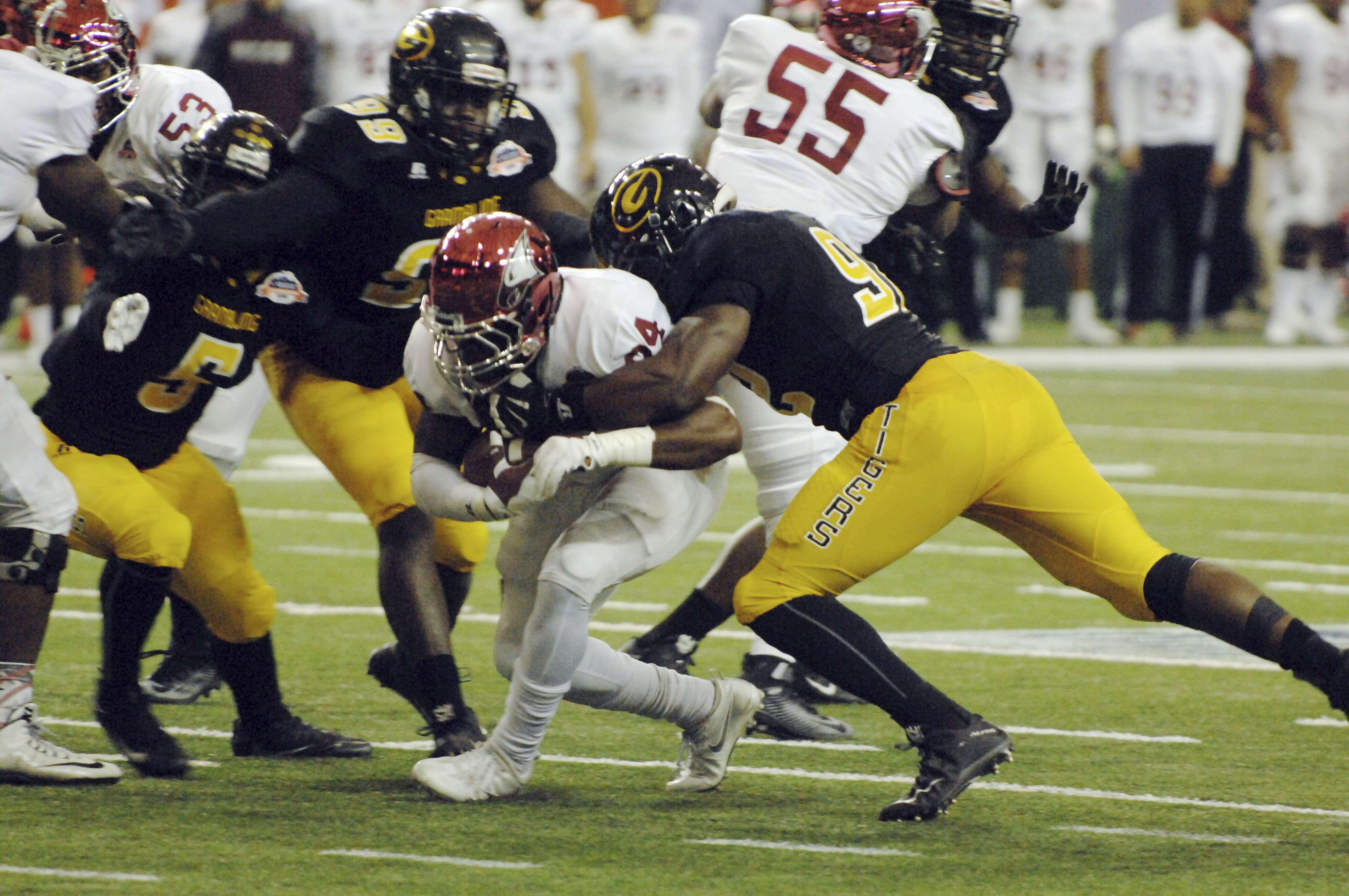 North Carolina Central running back Dorrel McClain is surrounded on the tackle by Grambling State defenders during the first half of the Celebration Bowl College football game at the Georgia Dome in Atlanta on Saturday, Dec. 17, 2016. (W.A. Bridges Jr./At