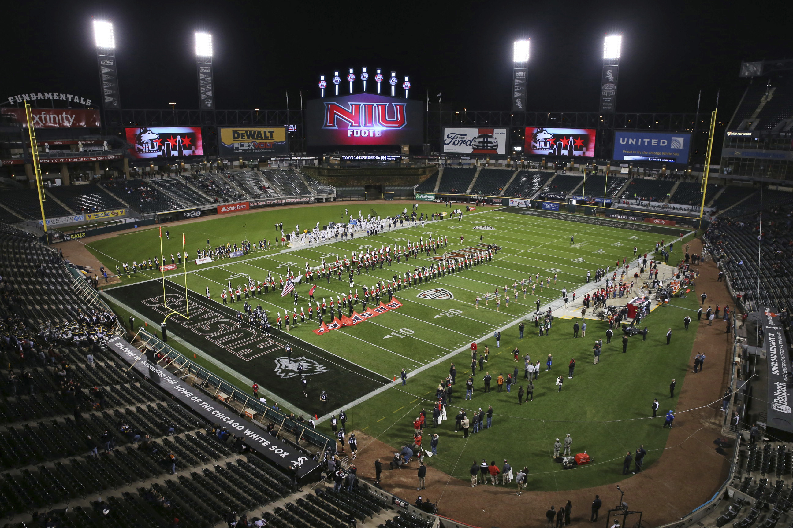 FILE - This Nov. 9, 2016 file photo shows Northern Illinois players taking the field for an NCAA college football game against Toledo in Chicago. As news about a football player boycott at Minnesota broke Thursday, Northern Illinois athletic director Sean