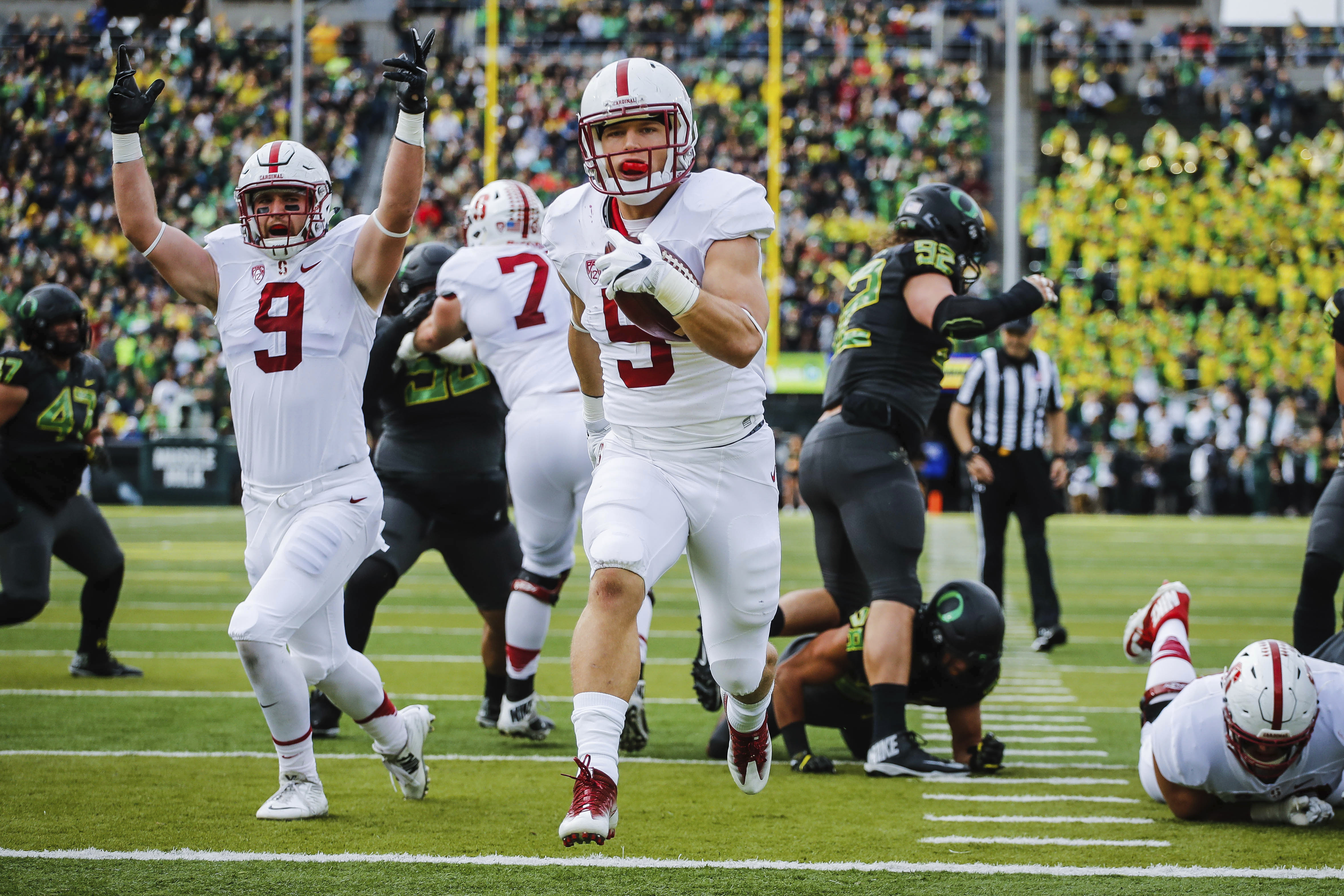 FILE - In this Nov. 12, 2016, file photo, Stanford running back Christian McCaffrey (5) runs for a touchdown in the first quarter of an NCAA college football game, in Eugene, Ore. McCaffrey is done playing college football. Stanfords star running back ann