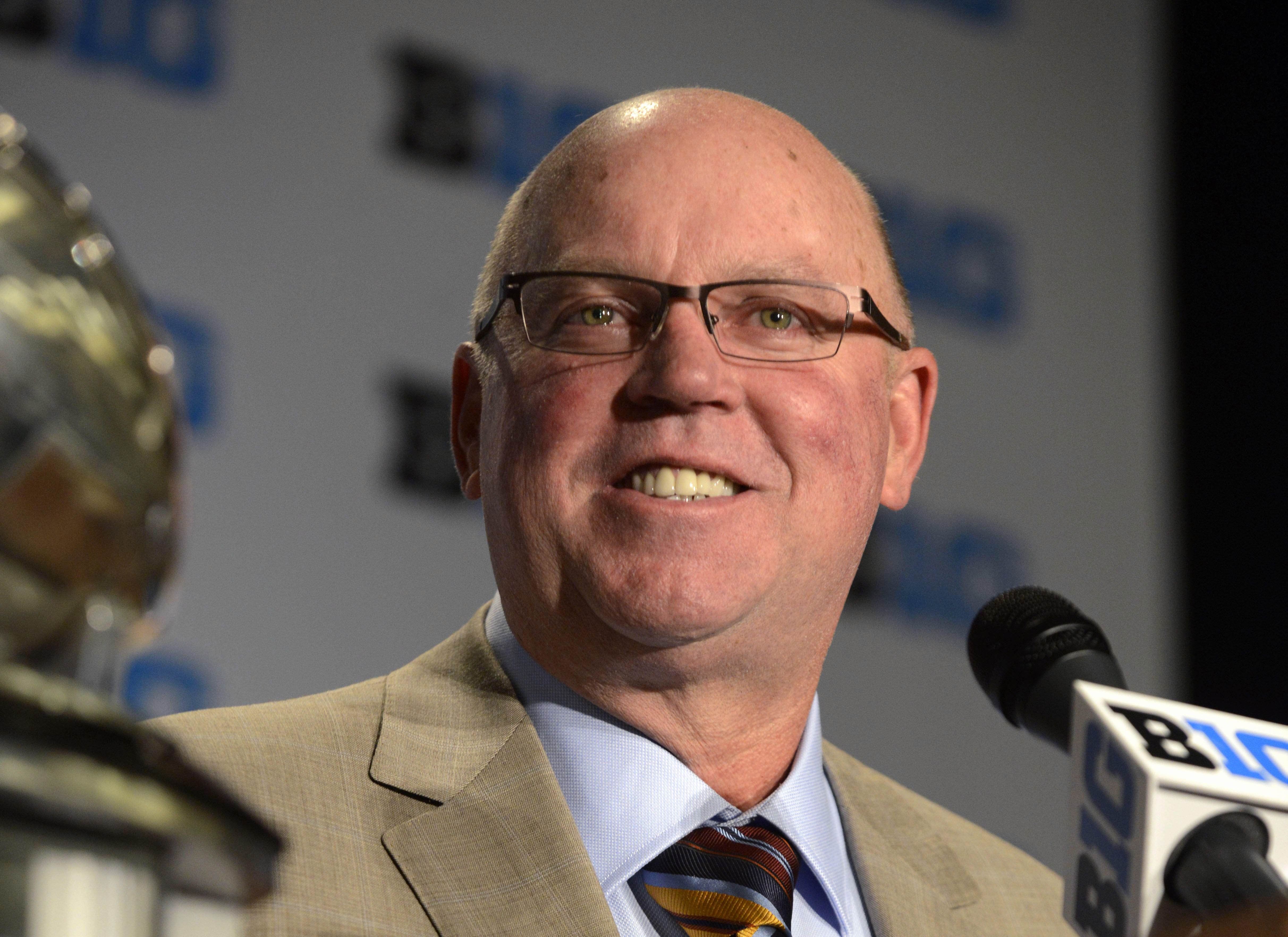 FILE - In this July 31, 2015, file photo, Minnesota head coach Jerry Kill speaks to the media during the NCAA college Big Ten Football Media Day in Chicago. Kansas State has hired former Minnesota football coach Jerry Kill as an associate athletic directo