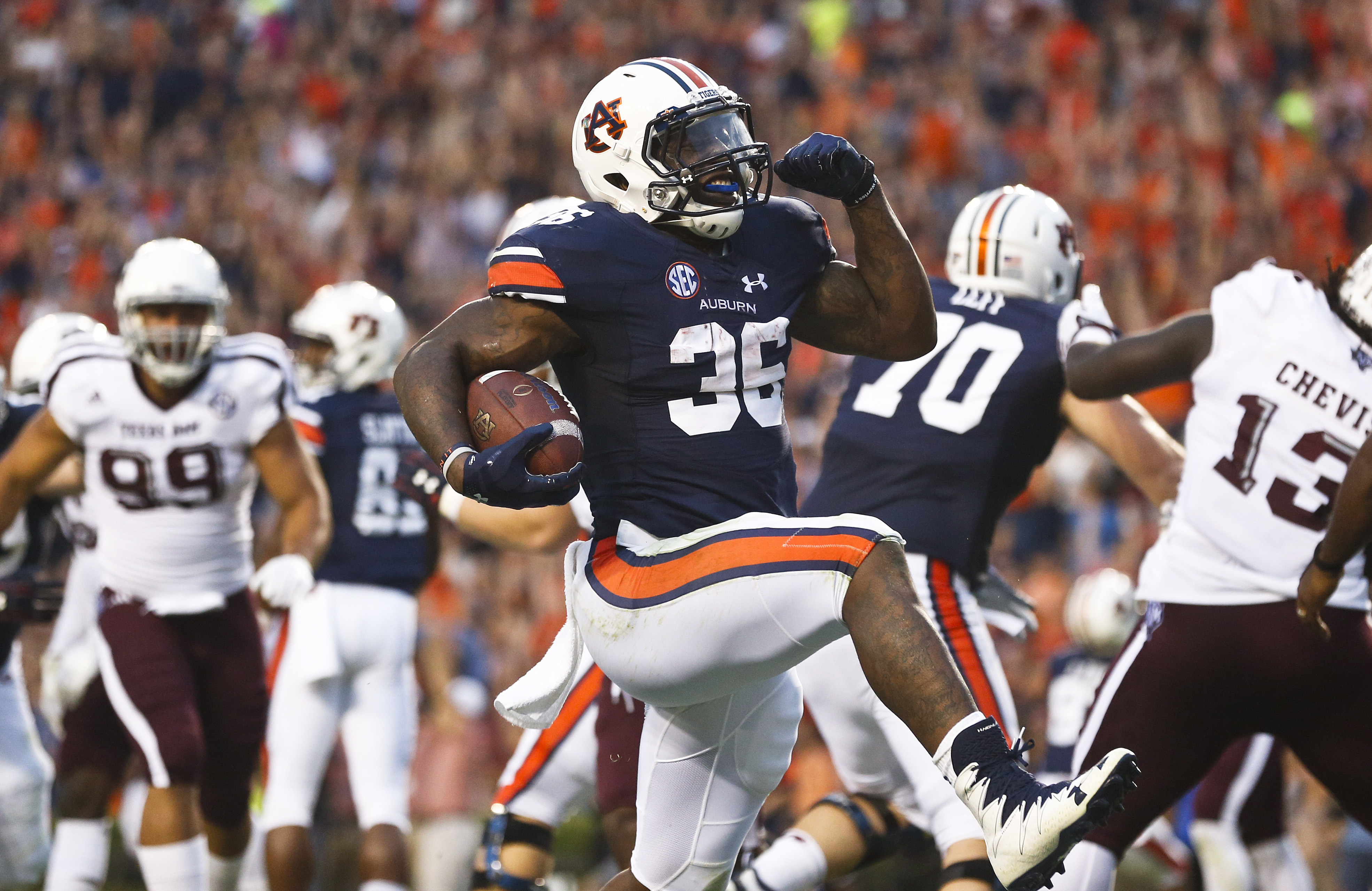 FILE - In this Sept. 17, 2016, file photo, Auburn running back Kamryn Pettway, center, scores a touchdown in the first half during an NCAA college football game against Texas A&M, in Auburn, Ala. Pettway came into the regular season as a converted fullbac