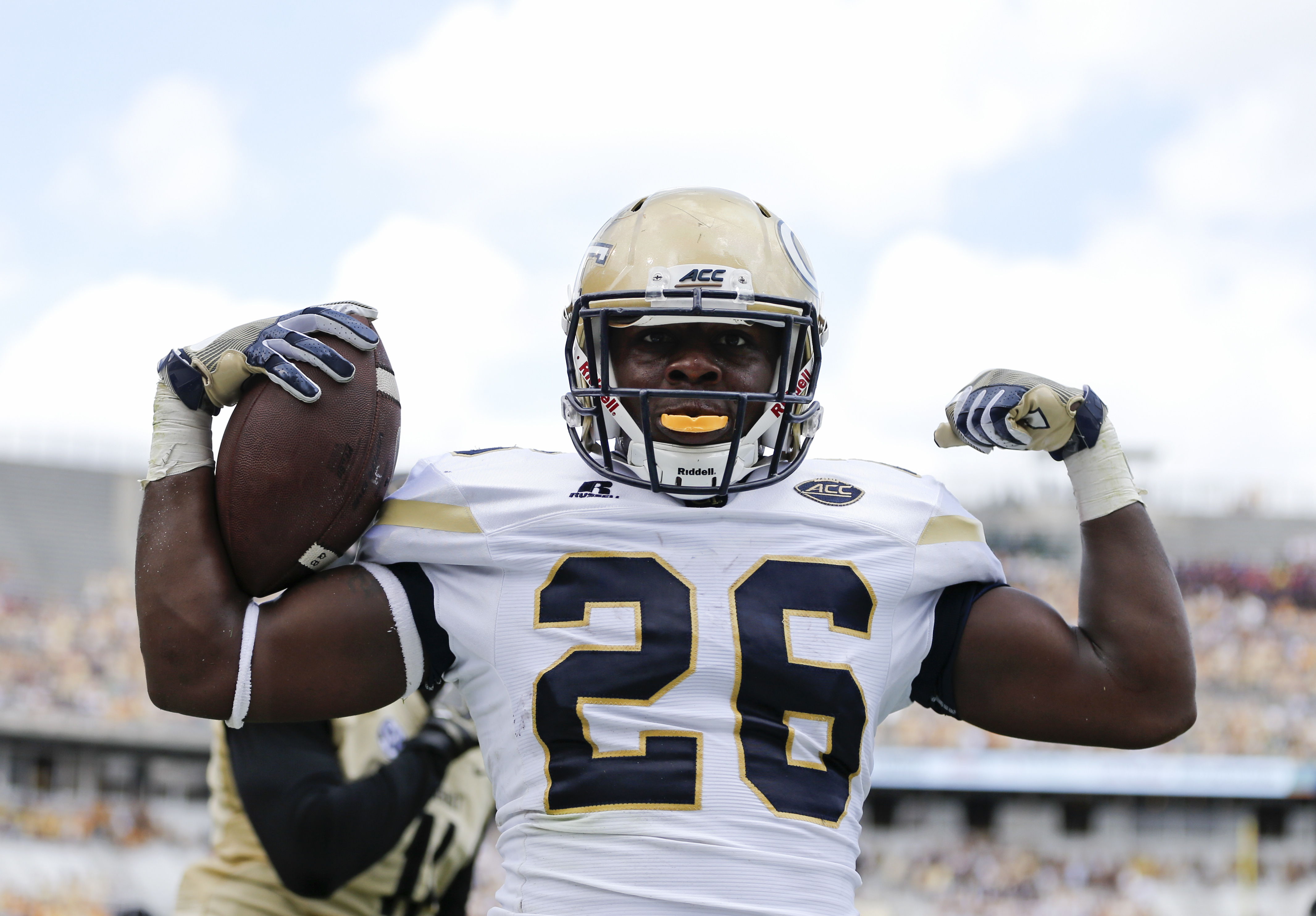 FILE- This Sept. 17, 2016, file photo shows Georgia Tech running back Dedrick Mills (26) celebrating after rushing for a touchdown in the first half of an NCAA college football game against Vanderbilt in Atlanta. Mills' freshman season for Georgia Tech wa
