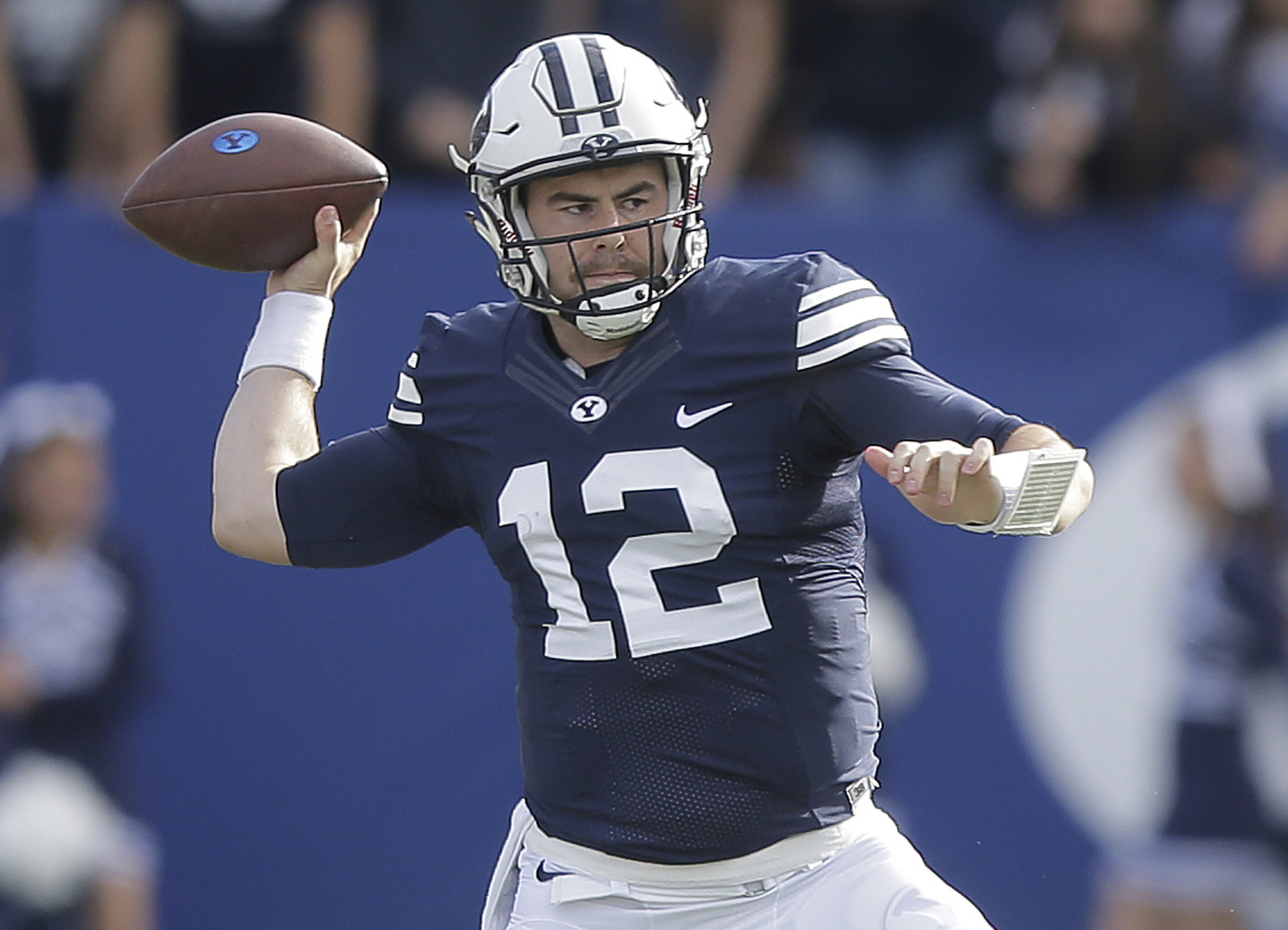 FILE - This Nov. 12, 2016, file photo, shows BYU quarterback Tanner Mangum (12) passing in the first half during an NCAA college football game against Southern Utah, in Provo, Utah. Wyoming meets BYU in the Poinsetta Bowl on Wednesday.  (AP Photo/Rick Bow