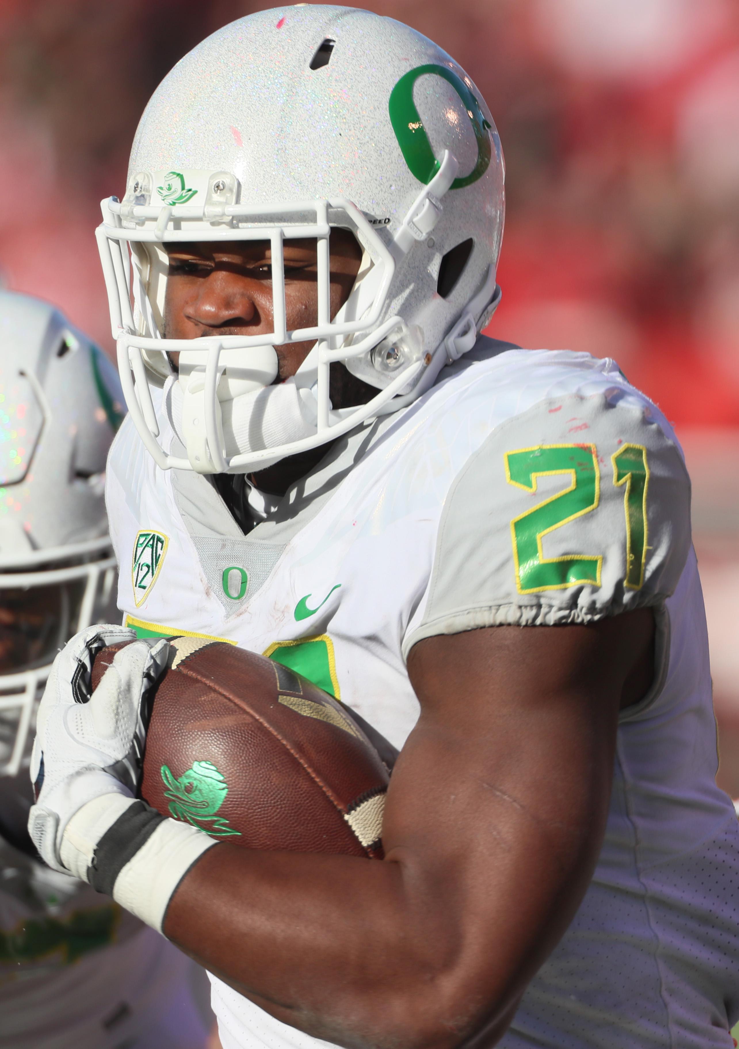 Oregon running back Royce Freeman (21) runs the ball in the second half during an NCAA college football game against Utah, Saturday, Nov. 19, 2016, in Salt Lake City. Oregon defeated Utah 30-28. (AP Photo/George Frey)