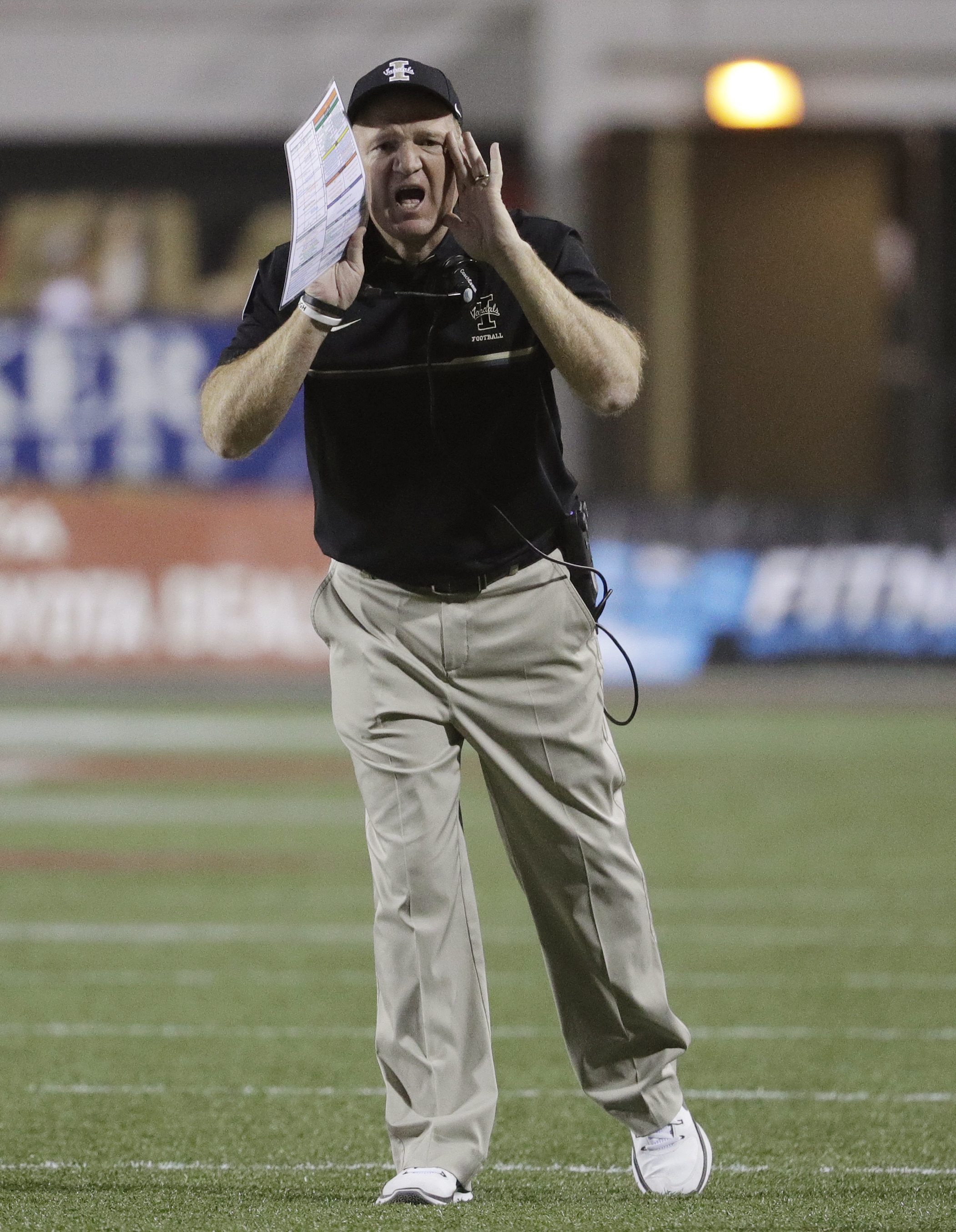 FILE - In this Sept. 24, 2016, file photo, Idaho head coach Paul Petrino instructs his players during the first half of an NCAA college football game against UNLV, in Las Vegas. Idaho and Colorado State had great finishes to their season after sluggish st