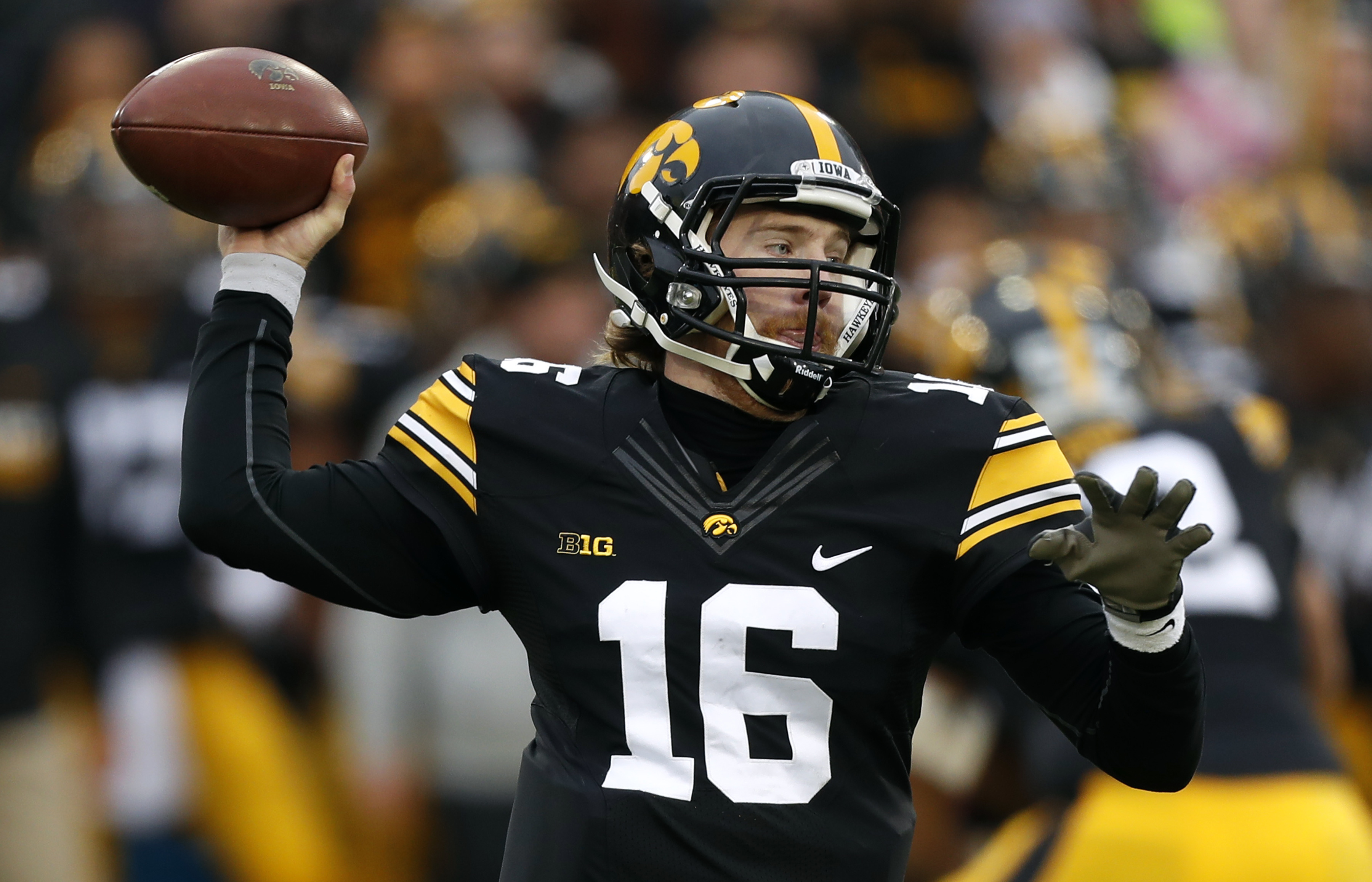 FILE - In this Friday, Nov. 25, 2016, file photo, Iowa quarterback C.J. Beathard throws a pass during the first half of an NCAA college football game against Nebraska in Iowa City, Iowa. Beathard enters his final game with Iowa for the Outback Bowl agains
