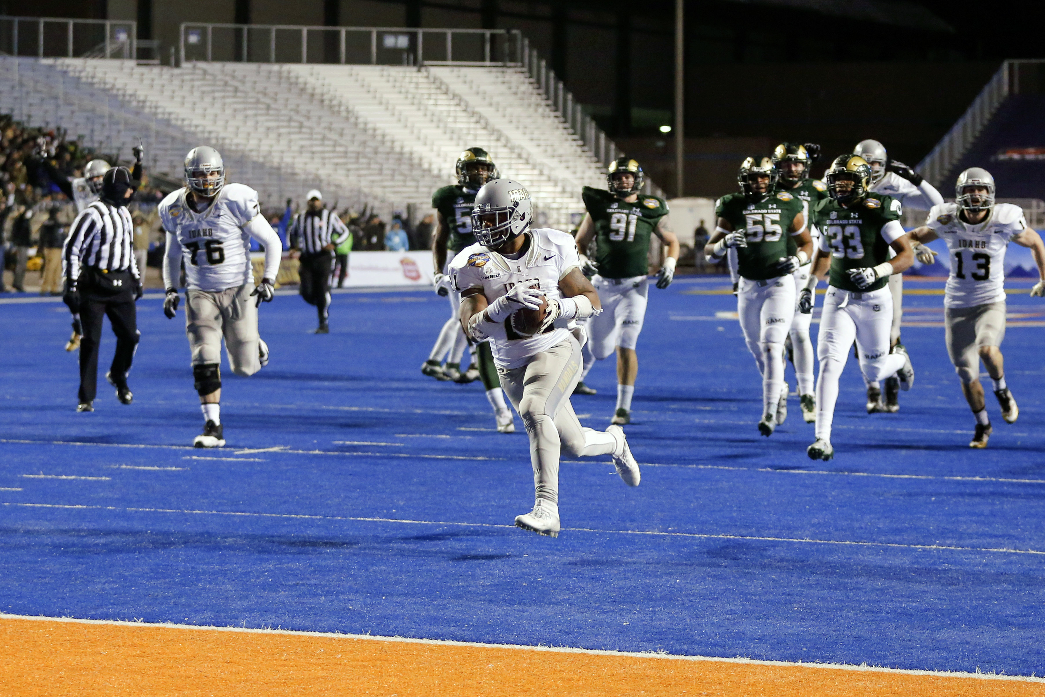 Idaho running back Isaiah Saunders (21) runs for a touchdown during the first half of the Famous Idaho Potato Bowl NCAA college football game against Colorado State in Boise, Idaho, Thursday, Dec. 22, 2016. (AP Photo/Otto Kitsinger)