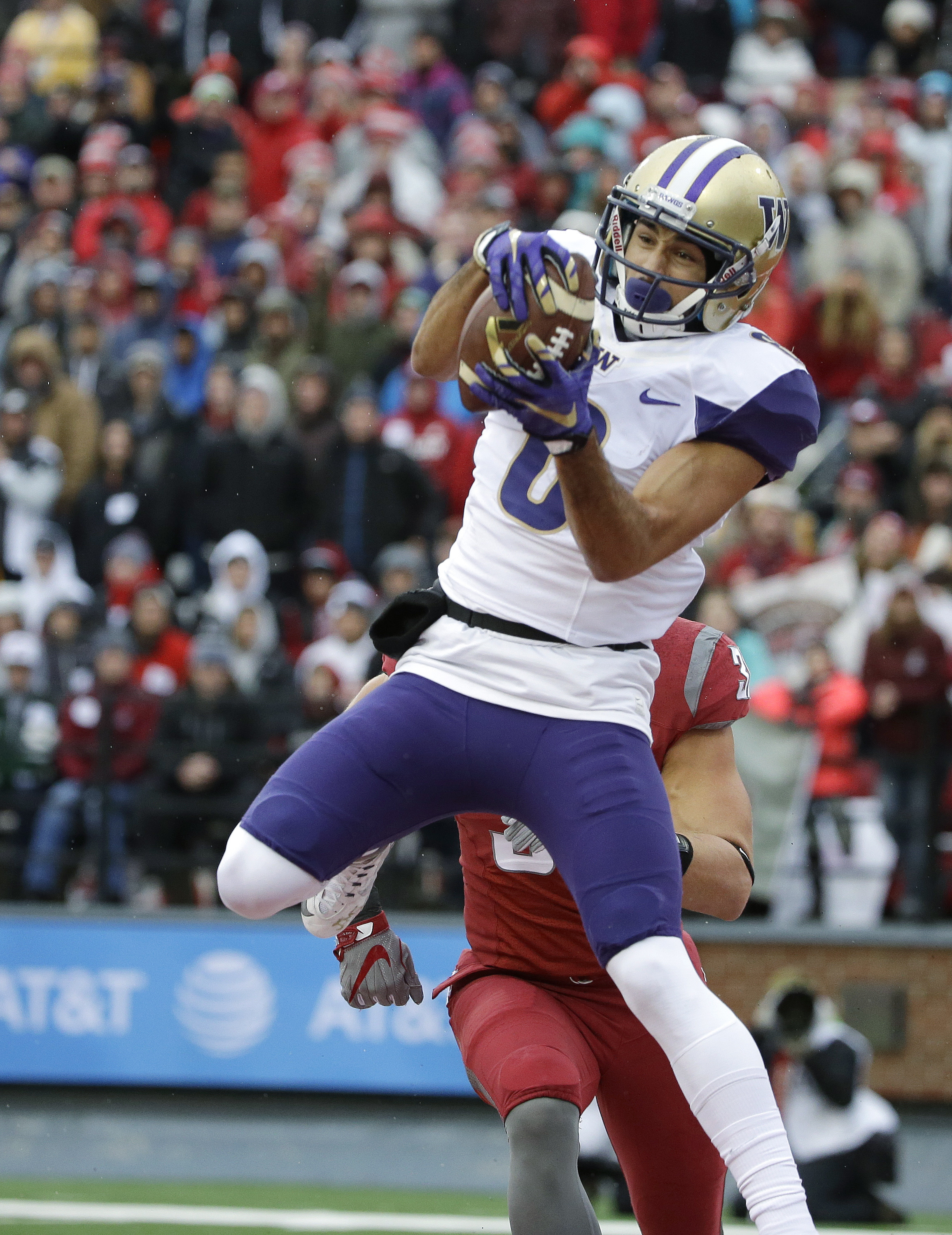 FILE - In this Nov. 25, 2016 file photo, Washington wide receiver Dante Pettis makes a catch in front of Washington State linebacker Isaac Dotson for a touchdown in the first half of an NCAA college football game, in Pullman, Wash. Throughout his first tw