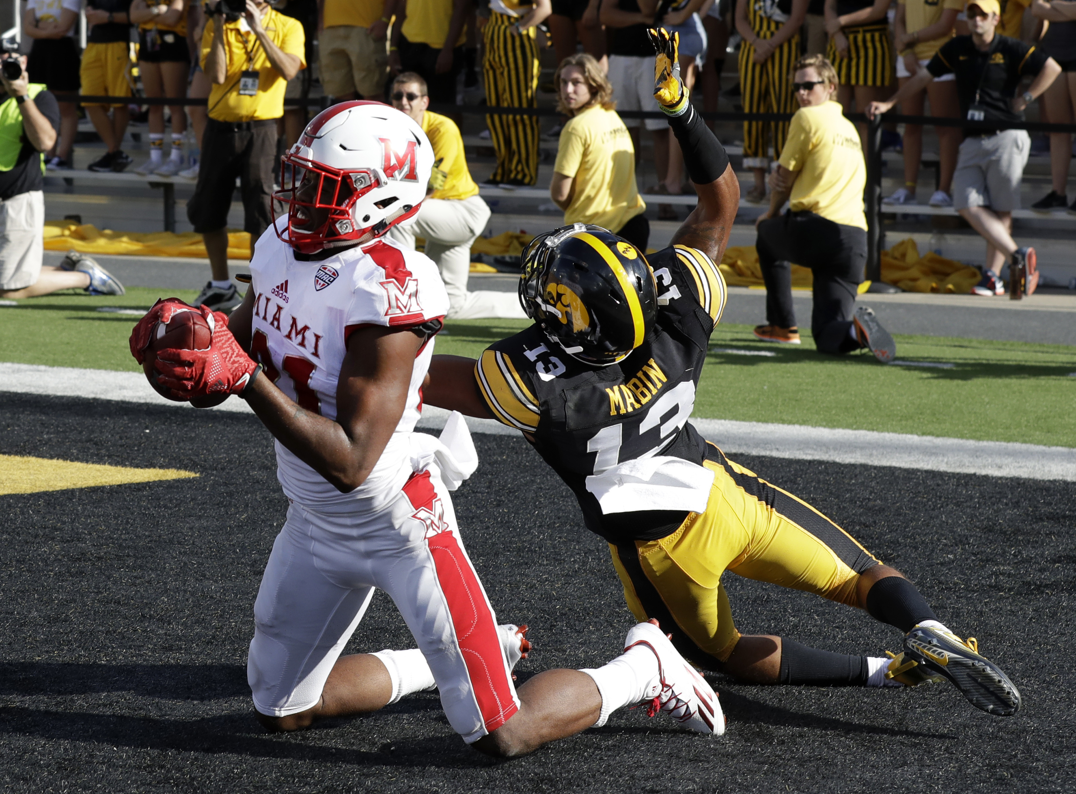 FILE - In this Saturday, Sept. 3, 2016, file photo, Miami of Ohio wide receiver James Gardner catches a touchdown pass as Iowa defensive back Greg Mabin tried to defend during the second half of an NCAA college football game in Iowa City, Iowa. So much fo