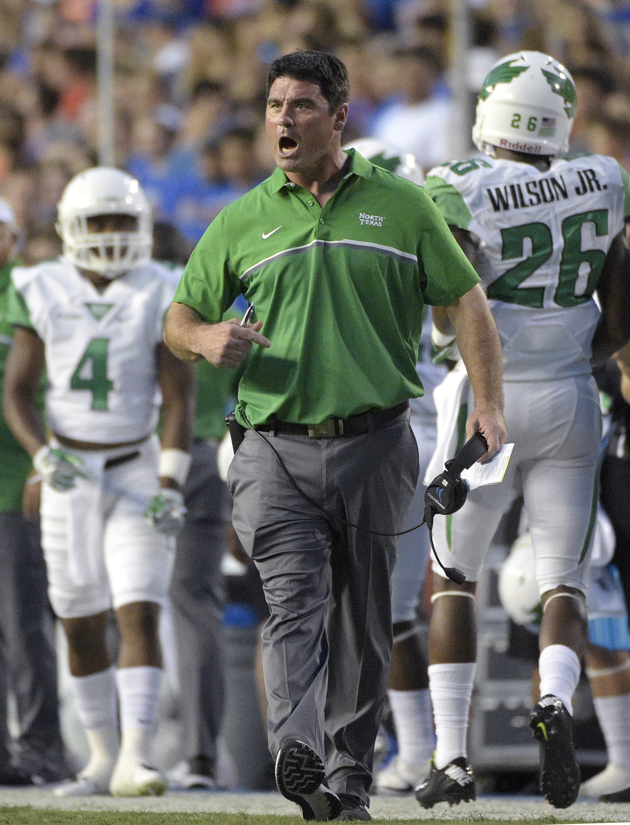 FILE - In this Saturday, Sept. 17, 2016, file photo, North Texas coach Seth Littrell, center, reacts after quarterback Mason Fine was sacked by Florida in the end zone for a safety during the first half of an NCAA college football game in Gainesville, Fla