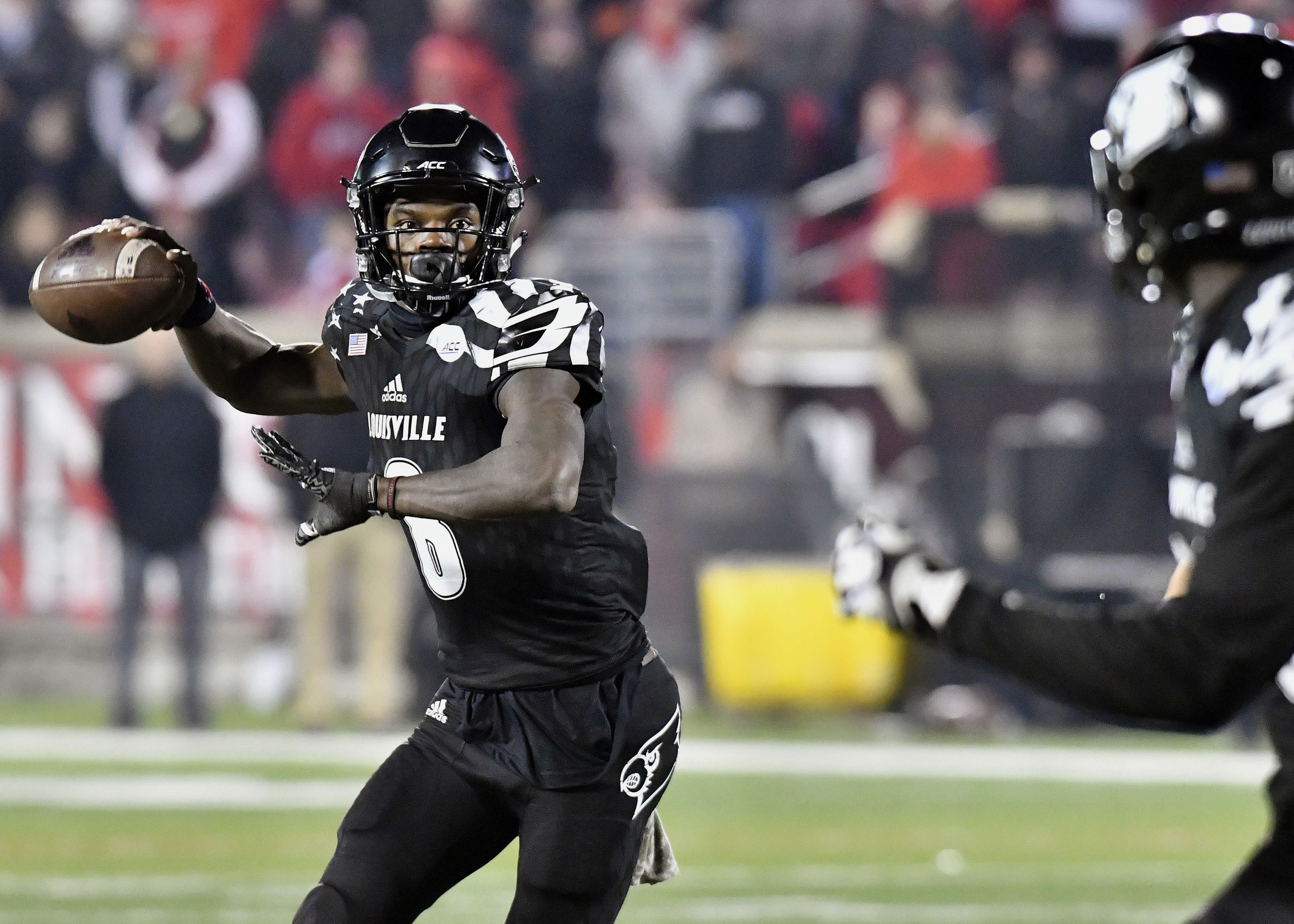 FILE - In this Nov. 12, 2016, file photo, Louisville quarterback Lamar Jackson attempts a pass during the second half of an NCAA college football game against Wake Forest in Louisville Ky. Playing in a bowl game is usually considered to be a reward for a