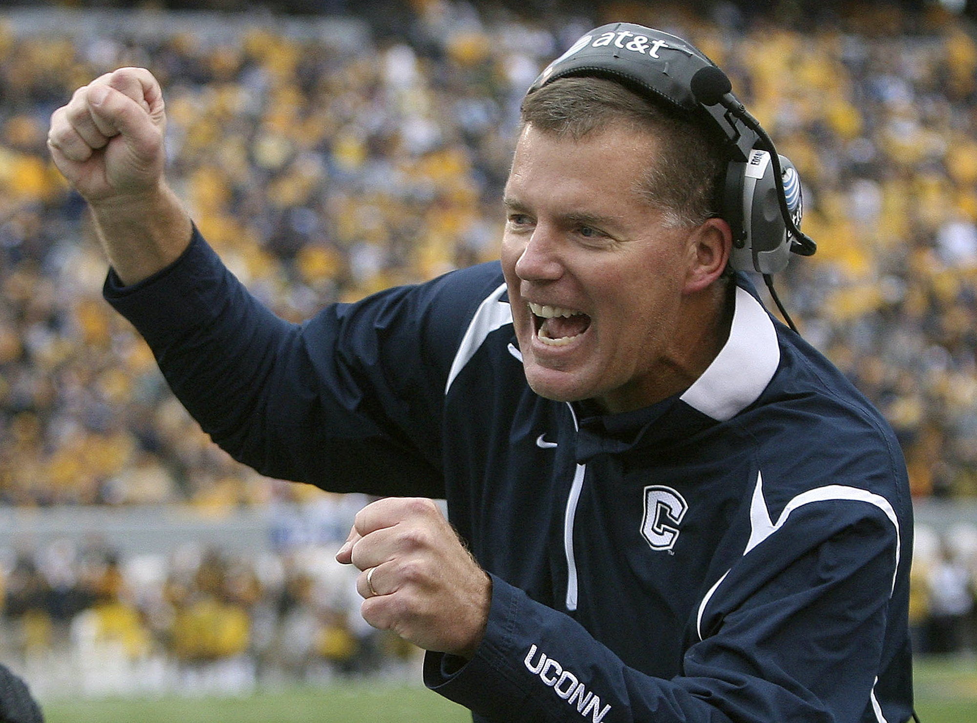 FILE - In this Oct. 24, 2009, file photo, Connecticut head coach Randy Edsall, greets a player after his team scored against West Virginia during an NCAA college football game in Morgantown, W.Va. Edsall, who coached UConn from 1999-2010, left for Marylan