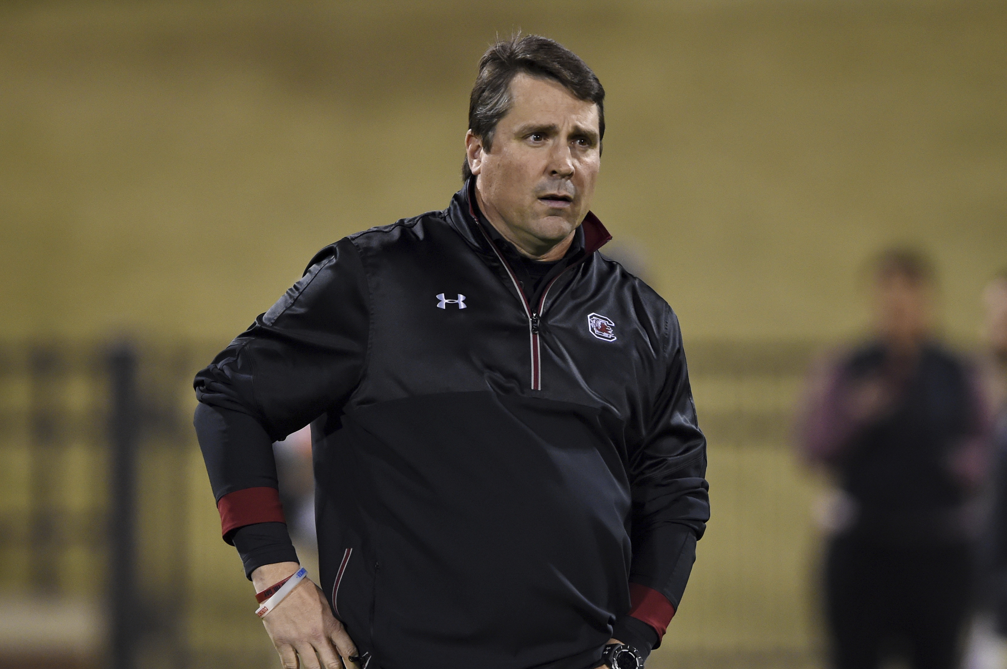 This Nov. 26, 2016 photo shows South Carolina head coach Will Muschamp walking the field before the start of an NCAA college football game against Clemson in Clemson, S.C. South Carolina will face South Florida on Thursday in the Birmingham Bowl. (AP Phot