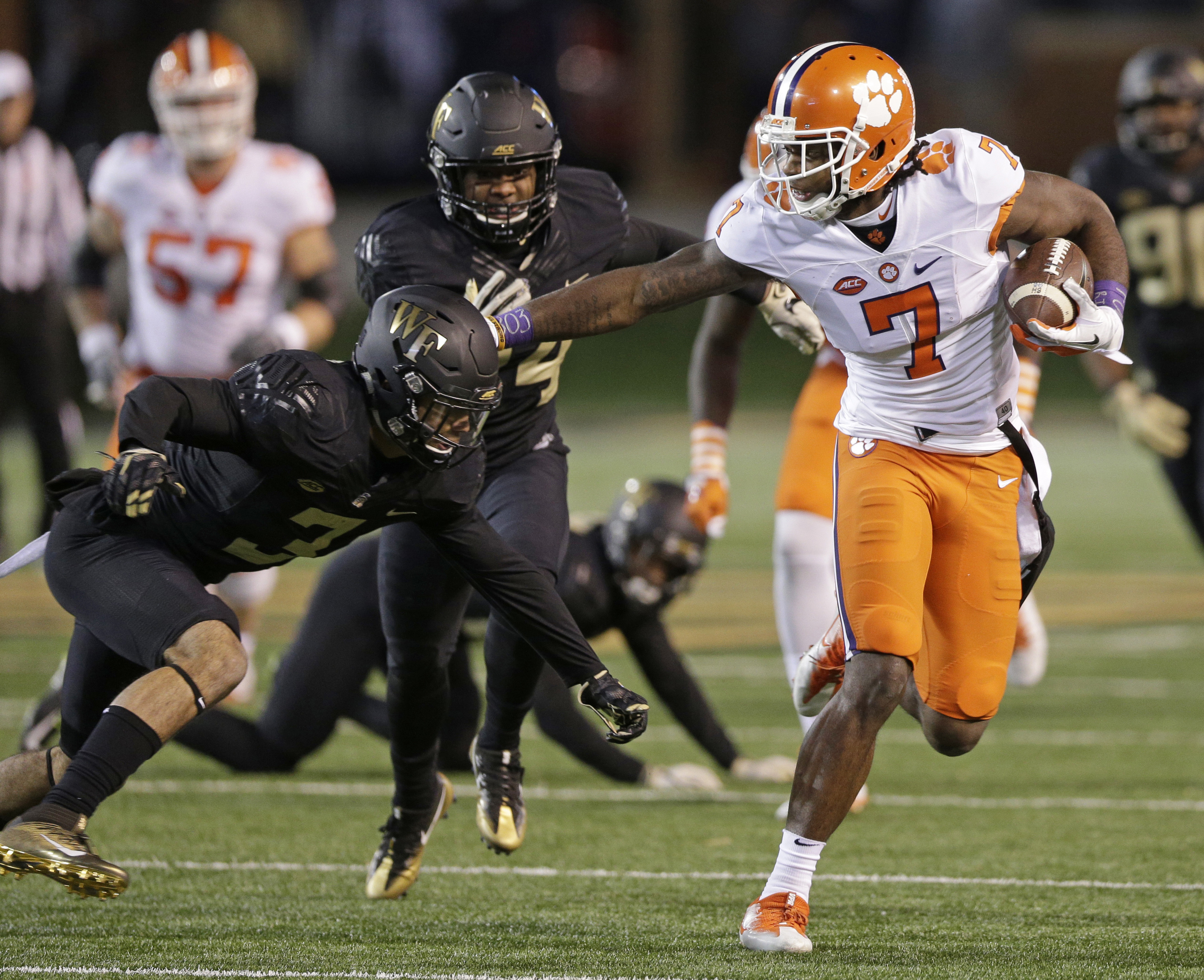 FILE - In a Saturday, Nov. 19, 2016 file photo, Clemson's Mike Williams (7) runs past Wake Forest's Jessie Bates III (3) during the first half of an NCAA college football game in Winston-Salem, N.C. After suffering a broken bone in his neck in 2015 in a c
