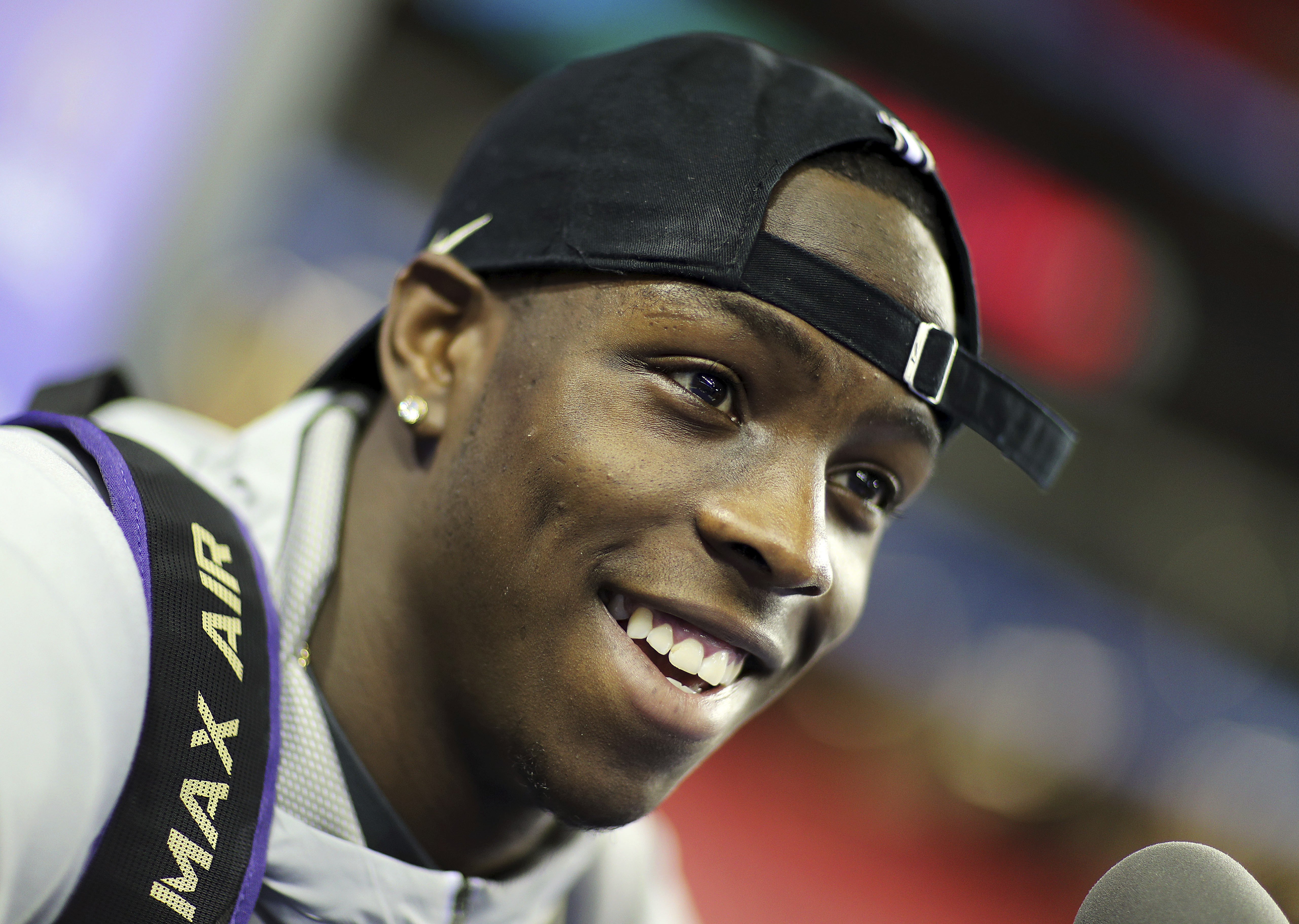 Washington's John Ross answers a question during media day for Saturday's Peach Bowl NCAA college football game against Alabama in Atlanta, Thursday, Dec. 29, 2016. (AP Photo/David Goldman)