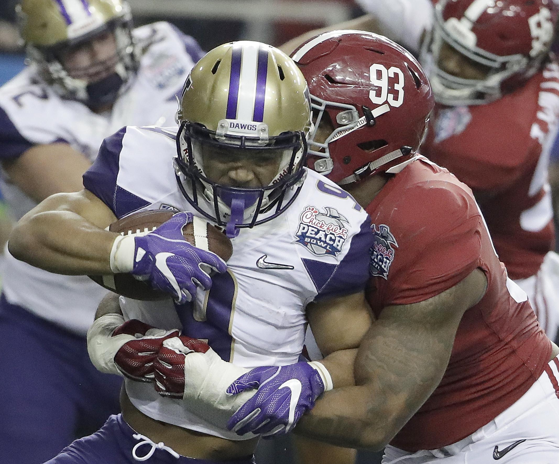 Alabama defensive lineman Jonathan Allen (93) tackles Washington running back Myles Gaskin (9) during the first half of the Peach Bowl NCAA college football playoff game, Saturday, Dec. 31, 2016, in Atlanta. (AP Photo/David Goldman)