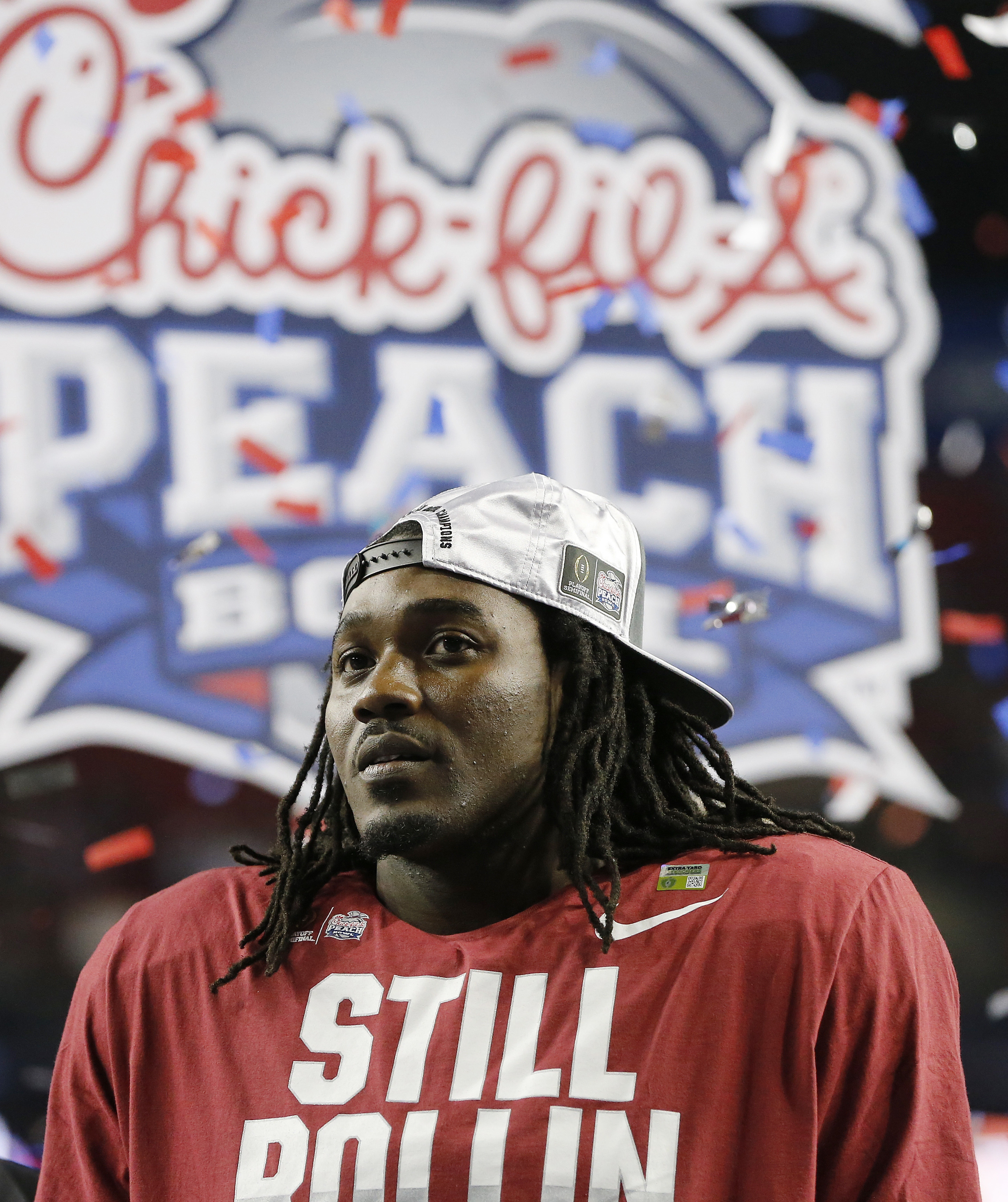 Alabama running back Bo Scarbrough stands on the stage after the Peach Bowl NCAA college football playoff game against Washington, Saturday, Dec. 31, 2016, in Atlanta. Alabama won 24-7. (AP Photo/John Bazemore)