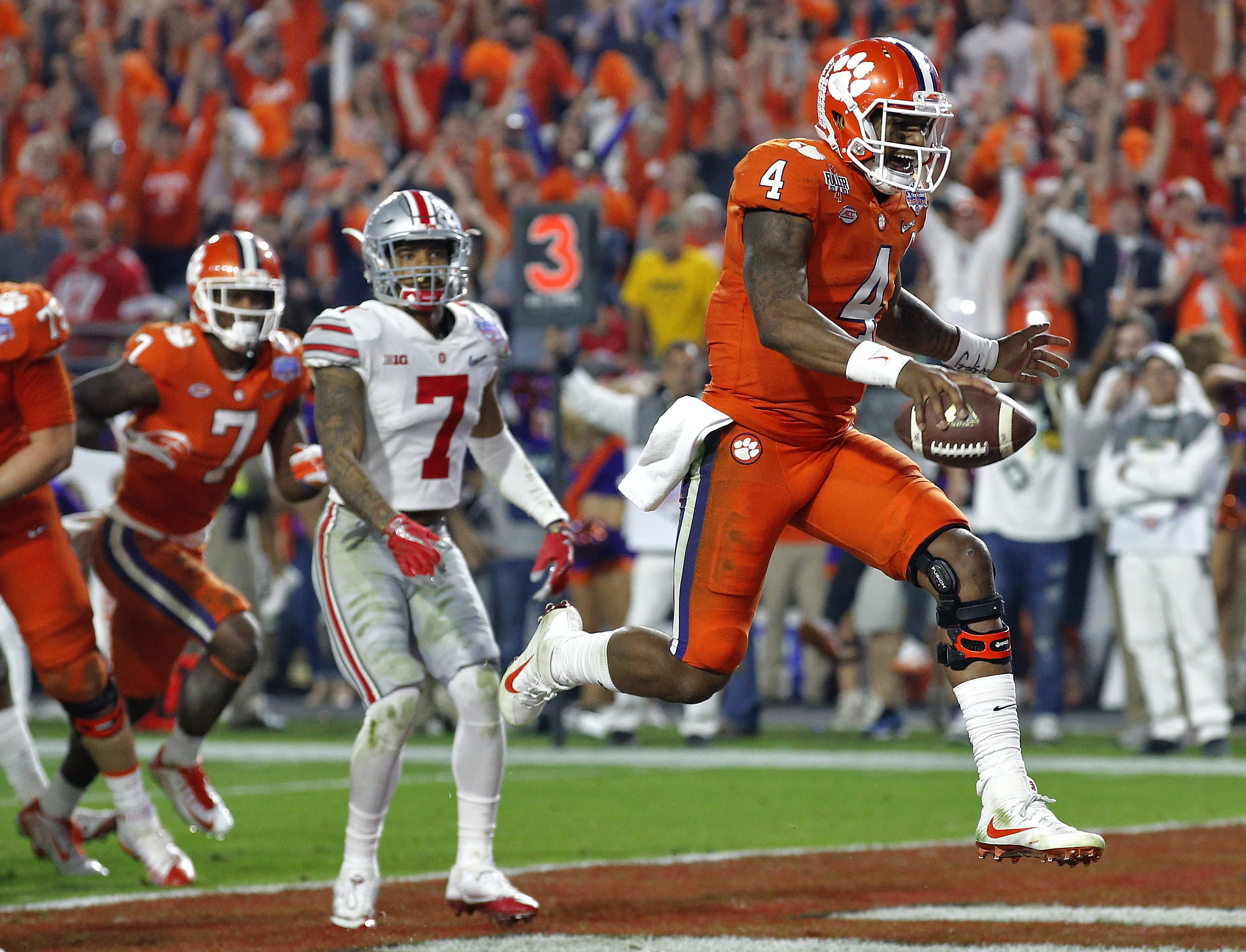 Clemson quarterback Deshaun Watson (4) runs in for a touchdown as Ohio State safety Damon Webb (7) watches during the second half of the Fiesta Bowl NCAA college football game, Saturday, Dec. 31, 2016, in Glendale, Ariz. (AP Photo/Ross D. Franklin)