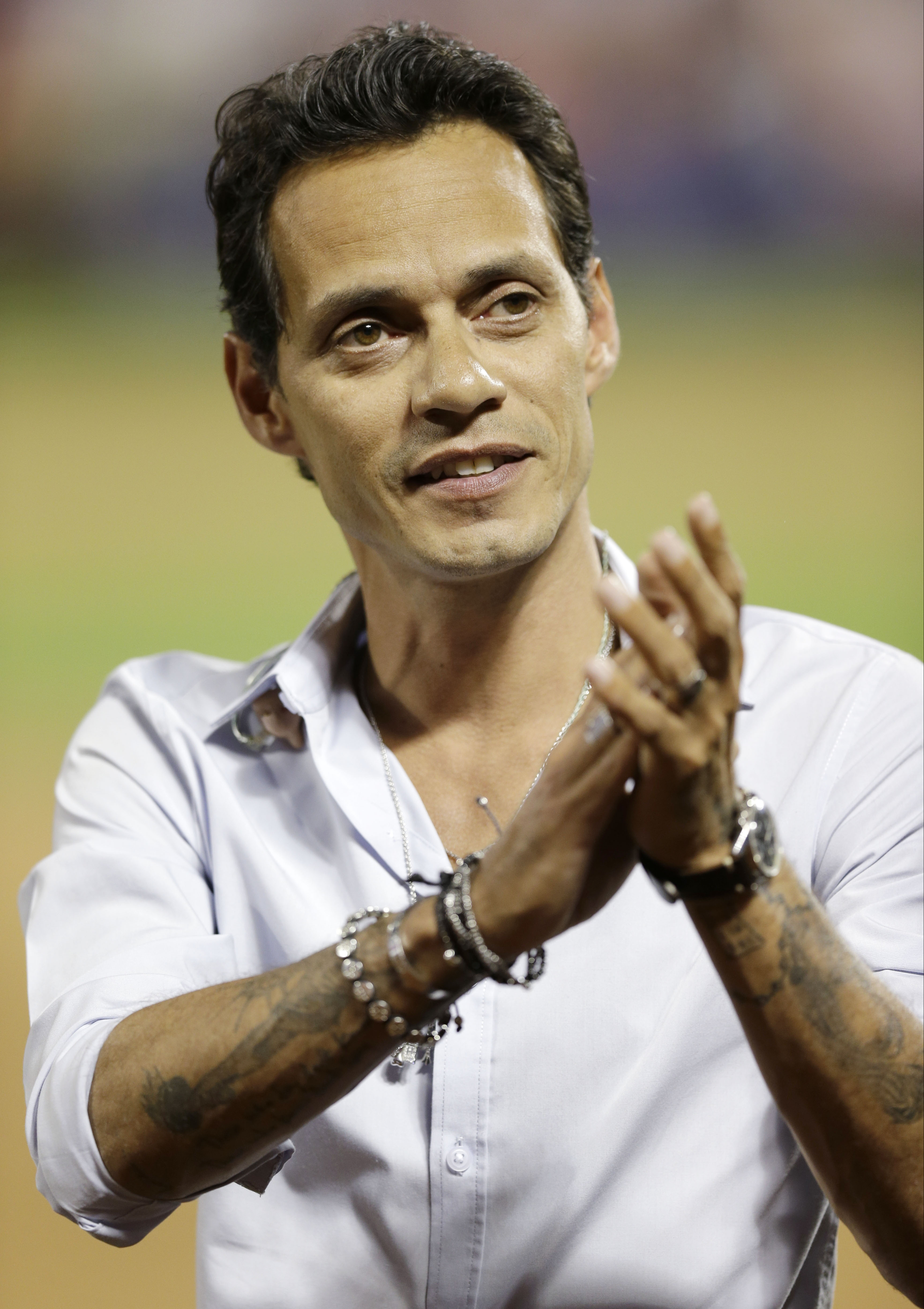 """FILE - This July 16, 2013 file photo shows singer Marc Anthony after singing """"God Bless America"""" during the seventh inning of the MLB All-Star baseball game in New York. Marc Anthony's album, """"3.0"""" will be released on Tuesday, July 23. (AP Photo/Kathy Wil"""