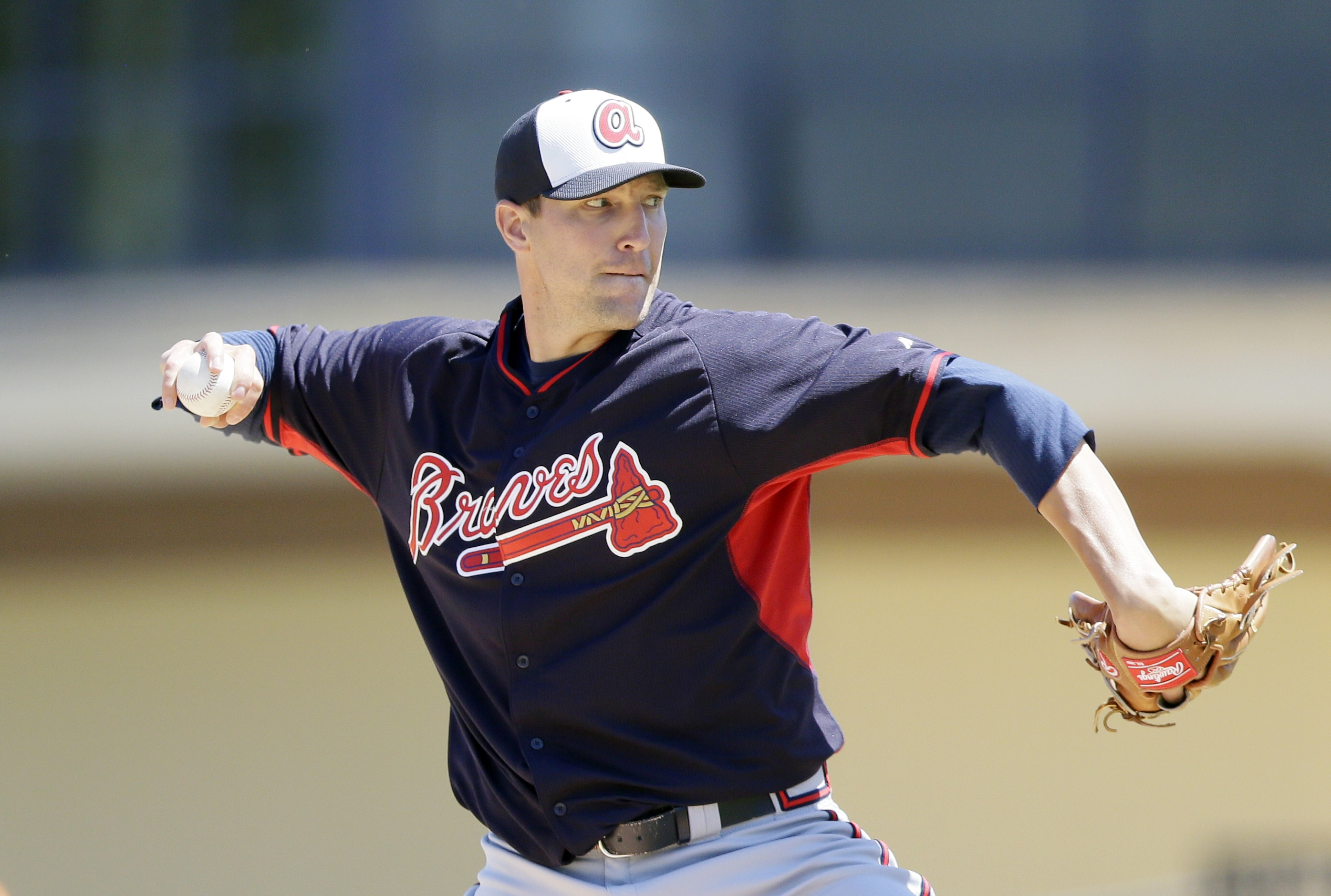 FILE - In this March 30, 2015, file photo, Atlanta Braves relief pitcher Jim Johnson throws during the fifth inning of a spring training exhibition baseball game against the Detroit Tigers in Lakeland, Fla. Reliever Jim Johnson is returning to the Atlanta