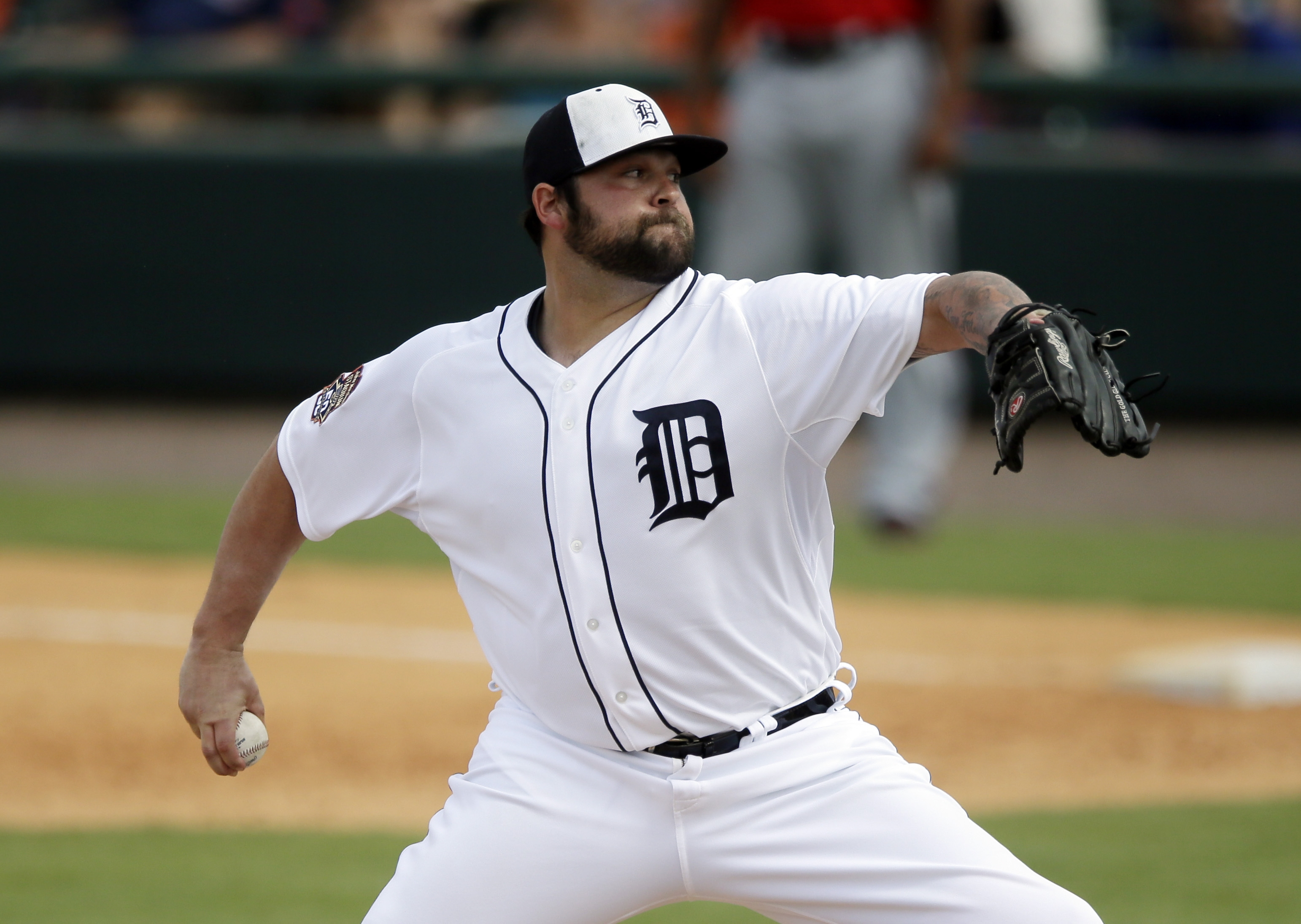 FILE - In this March 22, 2015, Detroit Tigers relief pitcher Joba Chamberlain throws during a spring training exhibition baseball game against the Washington Nationals in Lakeland, Fla. The Indians have signed free agent reliever Joba Chamberlain to a min