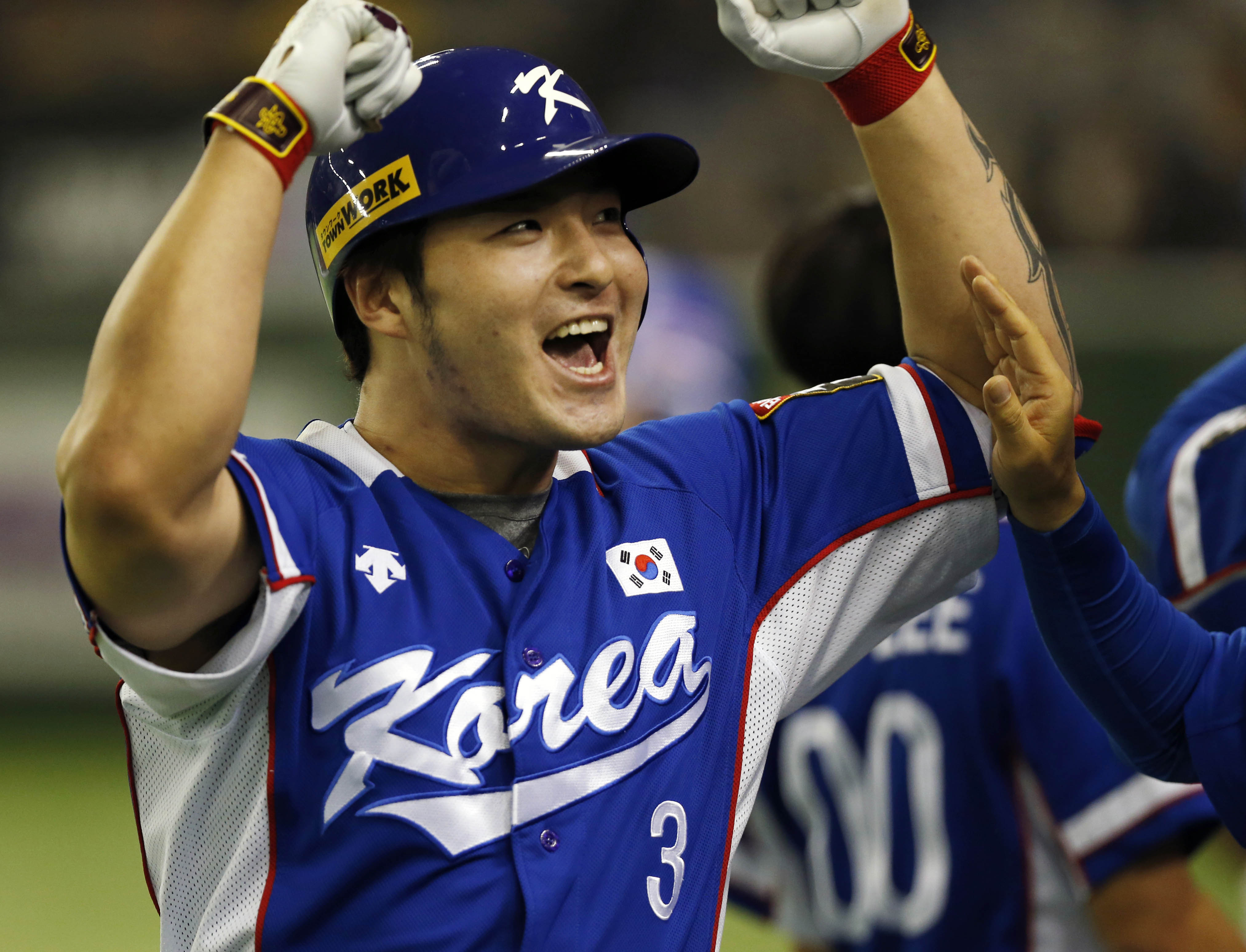 FILE - In this Saturday, Nov. 21, 2015 file photo, South Korea's Park Byung-ho celebrates at the bench after hitting a three-run home run against Team USA in the fourth inning of their final game at the Premier12 world baseball tournament at Tokyo Dome in
