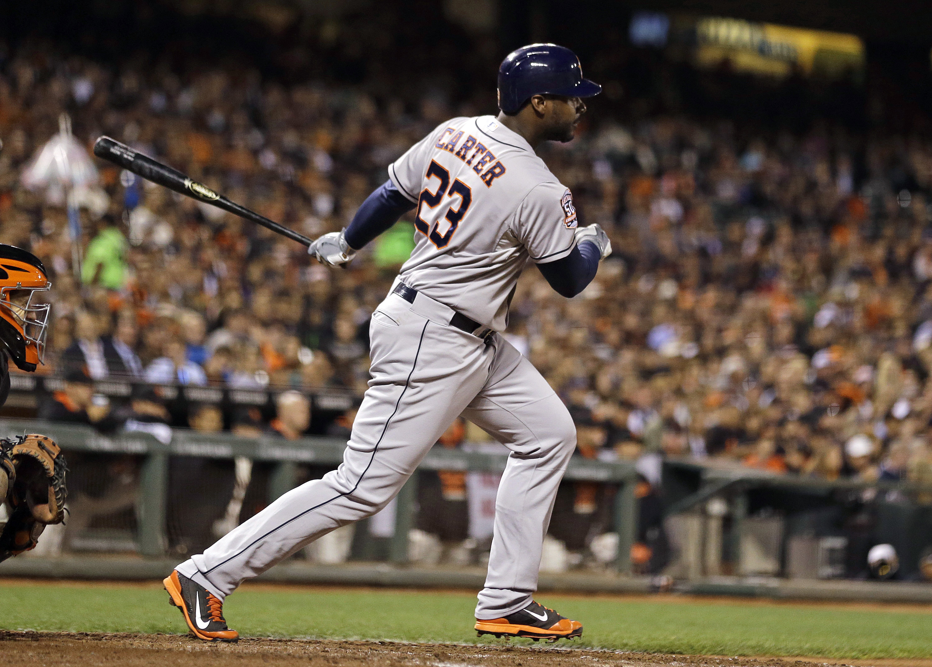 FILE - In this Aug. 11, 2015, file photo, Houston Astros' Chris Carter hits an RBI single off San Francisco Giants starting pitcher Madison Bumgarner in the seventh inning of their baseball game in San Francisco. Carter was among dozens of players who bec