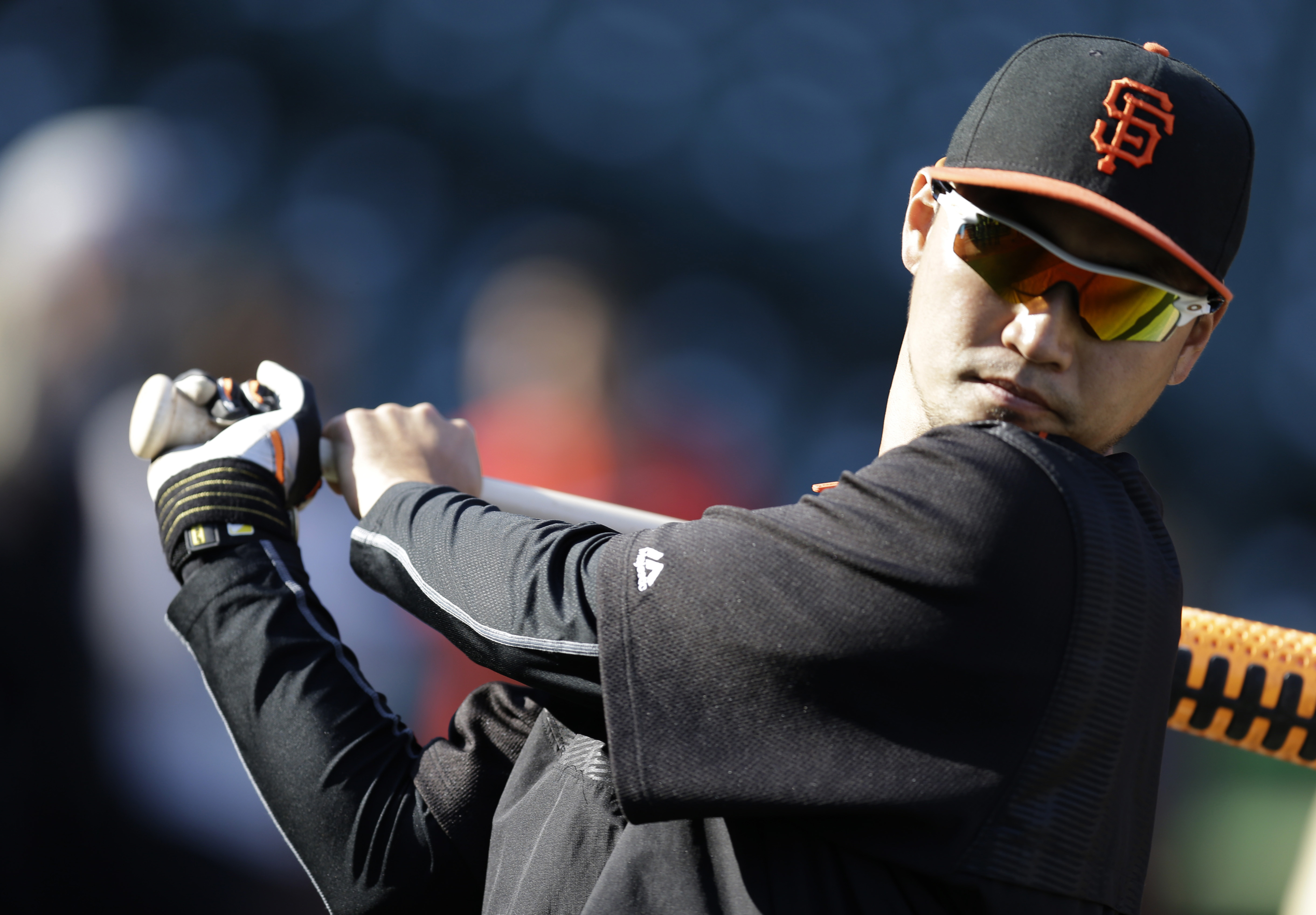 FILE - In this Wednesday, April 22, 2015 file photo, San Francisco Giants' Nori Aoki of Japan waits to bat during practice prior to a baseball game against the Los Angeles Dodgers in San Francisco. The Mariners kept up their offseason makeover on Thursday