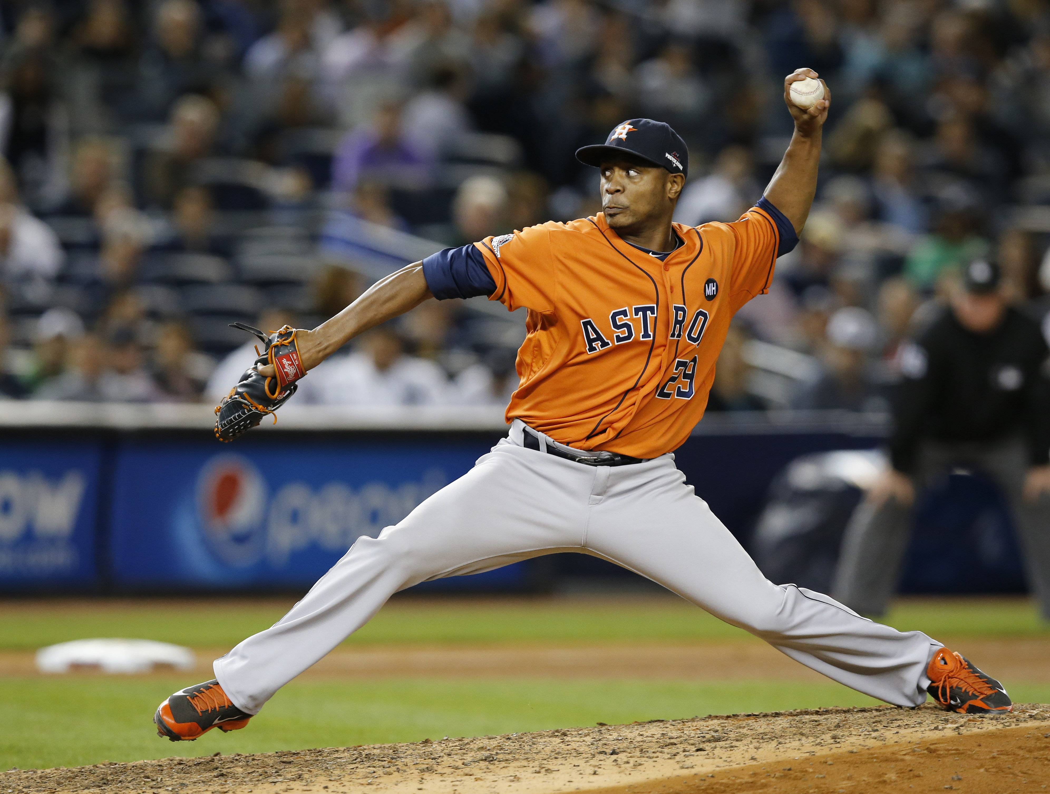 FILE - In this Oct. 6, 2015 file photo, Houston Astros relief pitcher Tony Sipp throws during the seventh inning of the American League wild card baseball game against the New York Yankees at Yankee Stadium in New York. A person familiar with the negotiat