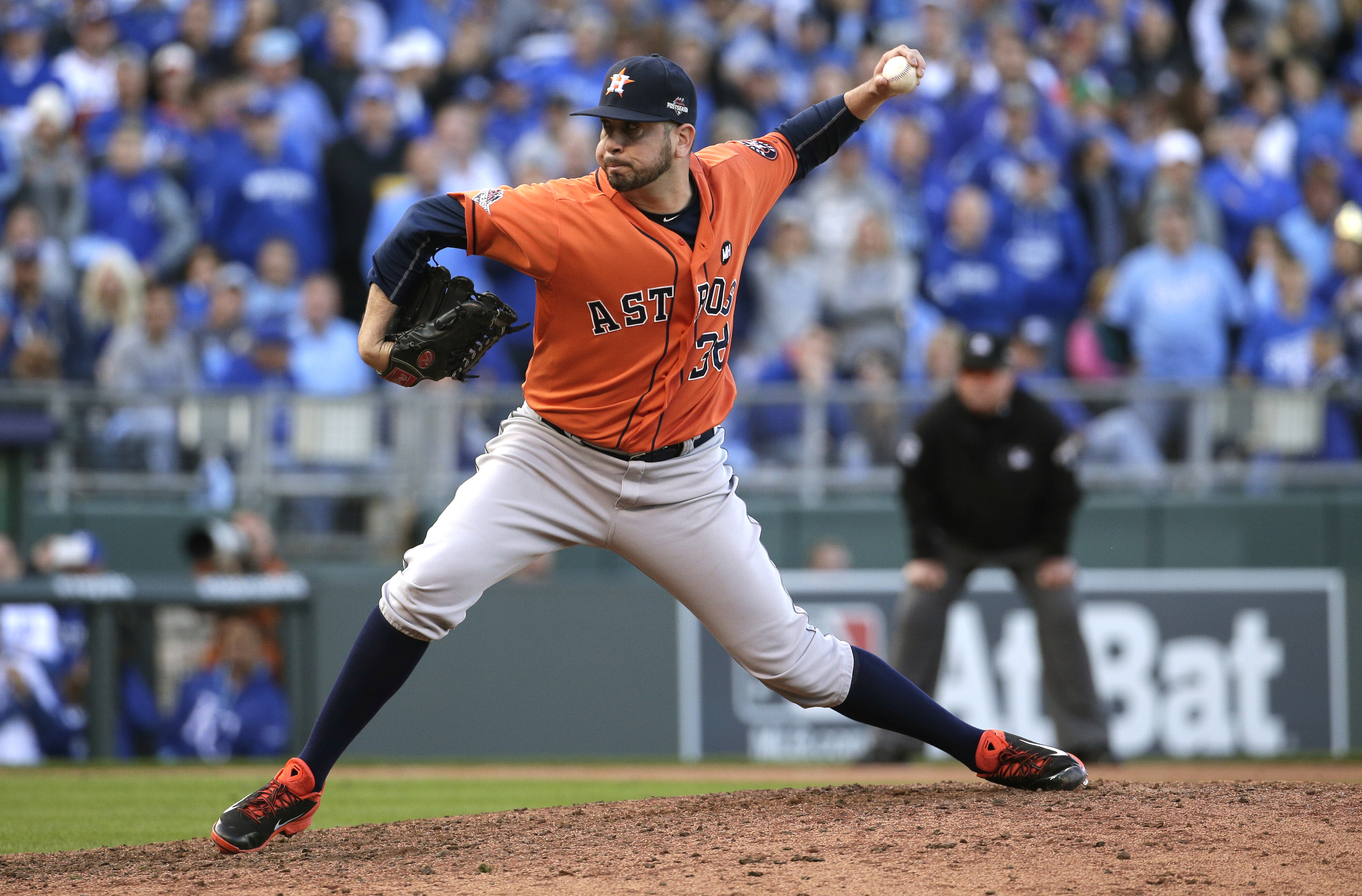FILE - In this Oct. 9, 2015 file photo, Houston Astros relief pitcher Oliver Perez throws a pitch during the sixth inning of Game 2 in baseball's American League Division Series against the Kansas City Royals, in Kansas City, Mo. Rebuilding their middle r