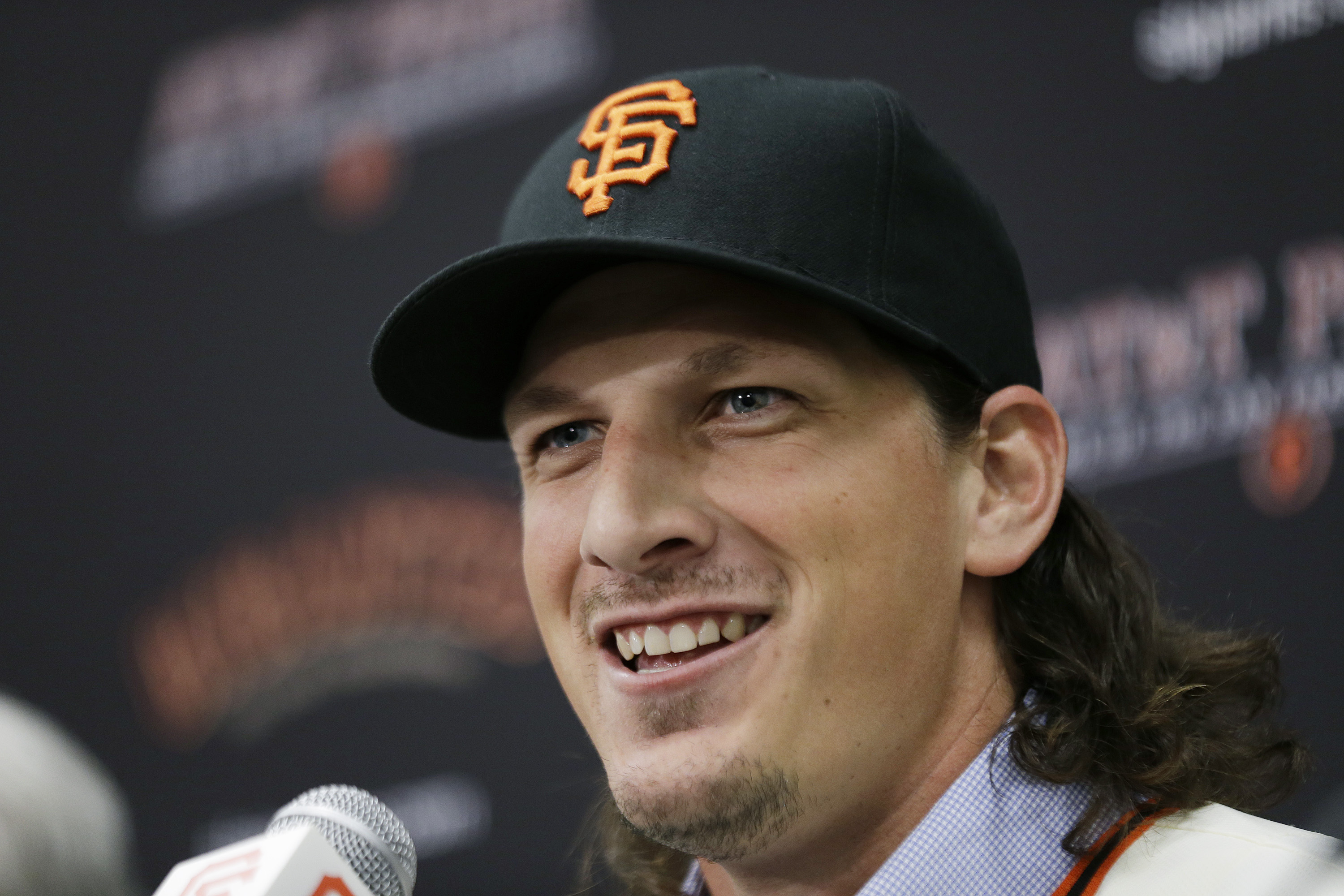 San Francisco Giants pitcher Jeff Samardzija smiles during a news conference Friday, Dec. 11, 2015, in San Francisco. The Giants introduced right-hander Samardzija, who signed a $90 million, five-year deal. (AP Photo/Eric Risberg)