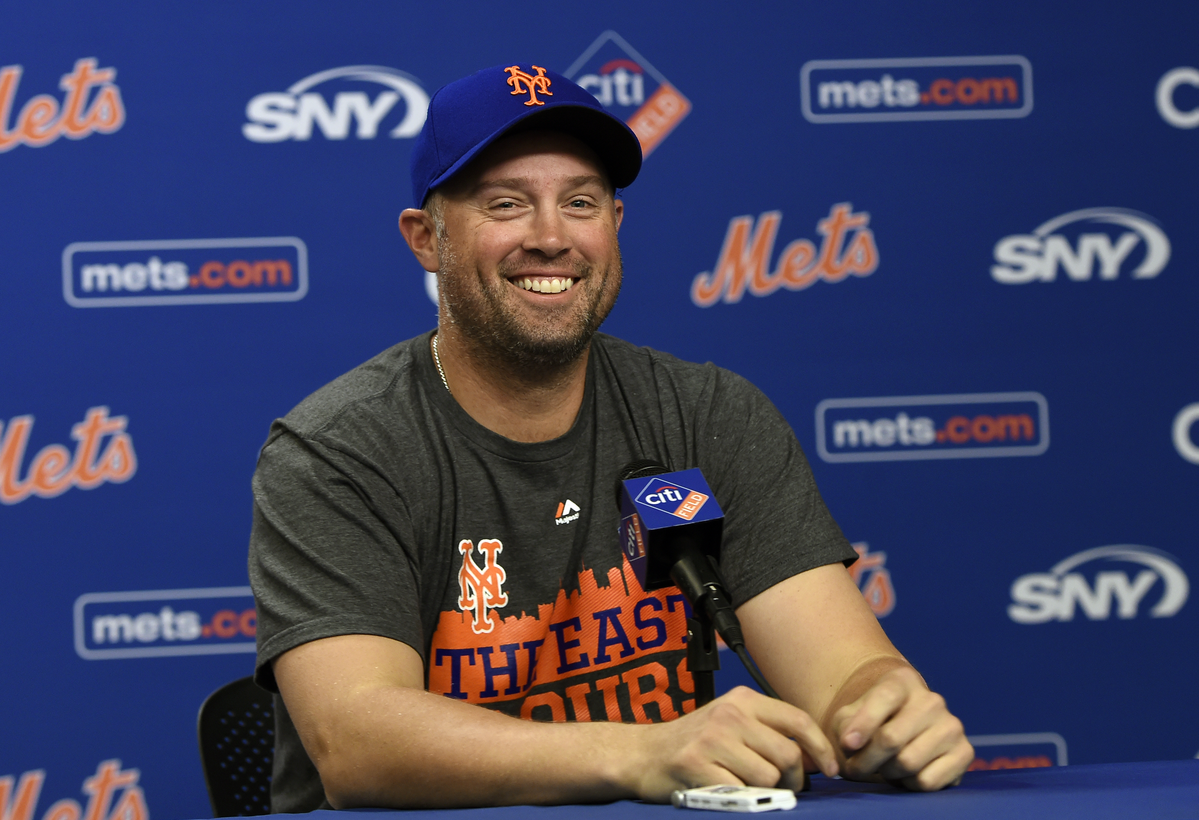 New York Mets' Michael Cuddyer smiles as he speaks to the media during a press conference prior today's workout at Citi Field for NLDS series against the Los Angeles Dodgers, Tuesday, Oct. 6, 2015, in New York. (AP Photo/Kathy Kmonicek)