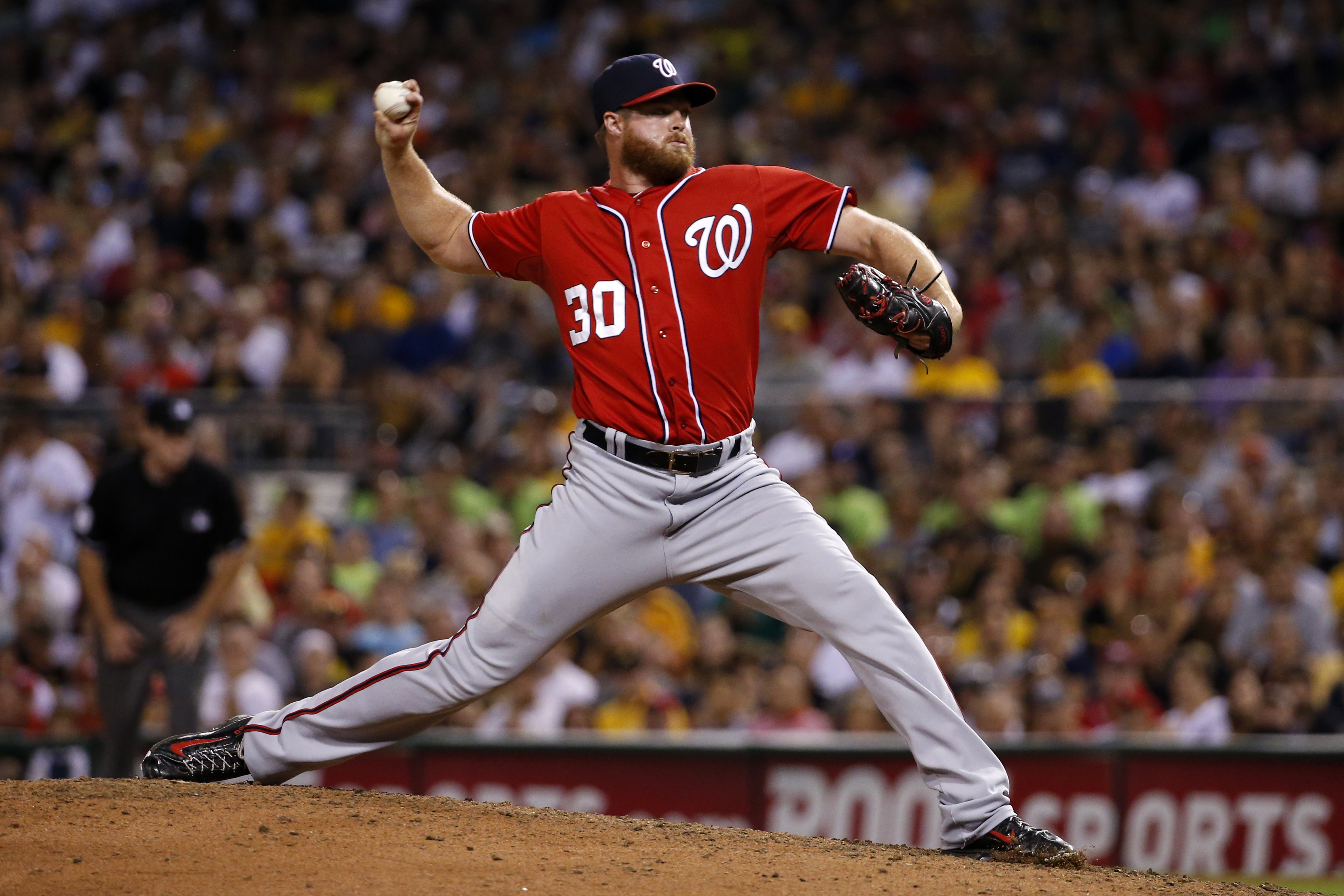 Washington Nationals relief pitcher Aaron Barrett (30) delivers during a baseball game against the Pittsburgh Pirates in Pittsburgh, Saturday, July 25, 2015. (AP Photo/Gene J. Puskar)