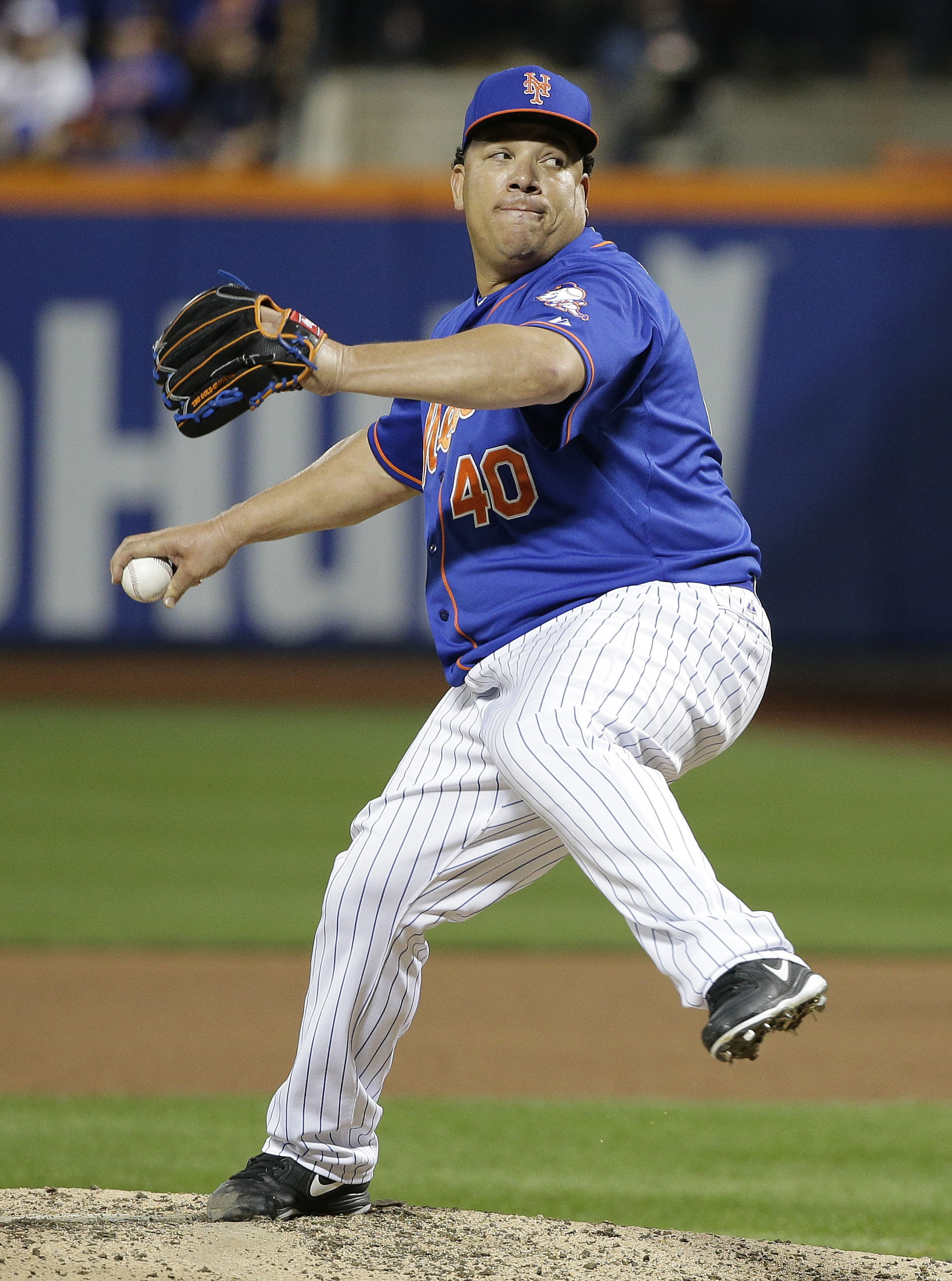 FILE - In this Monday, Oct. 12, 2015 file photo, New York Mets pitcher Bartolo Colon (40) delivers against the Los Angeles Dodgers during the sixth inning of baseball's Game 3 of the National League Division Series in New York. A person familiar with the