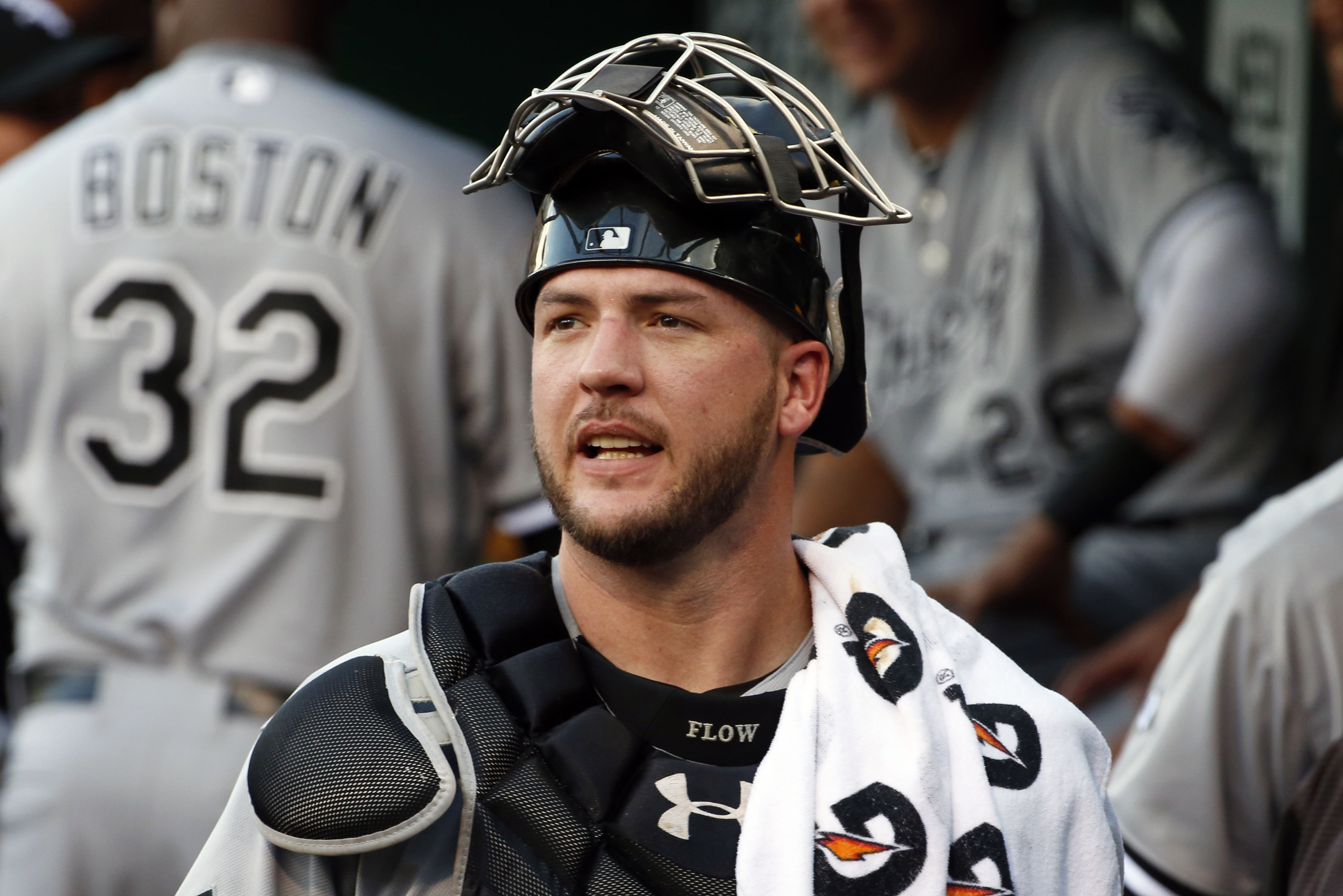 FILE - In this Monday, June 15, 2015 file photo, Chicago White Sox catcher Tyler Flowers walks through the dugout before a baseball game against the Pittsburgh Pirates in Pittsburgh. The Atlanta Braves have agreed to terms on a two-year, $5.3 million deal