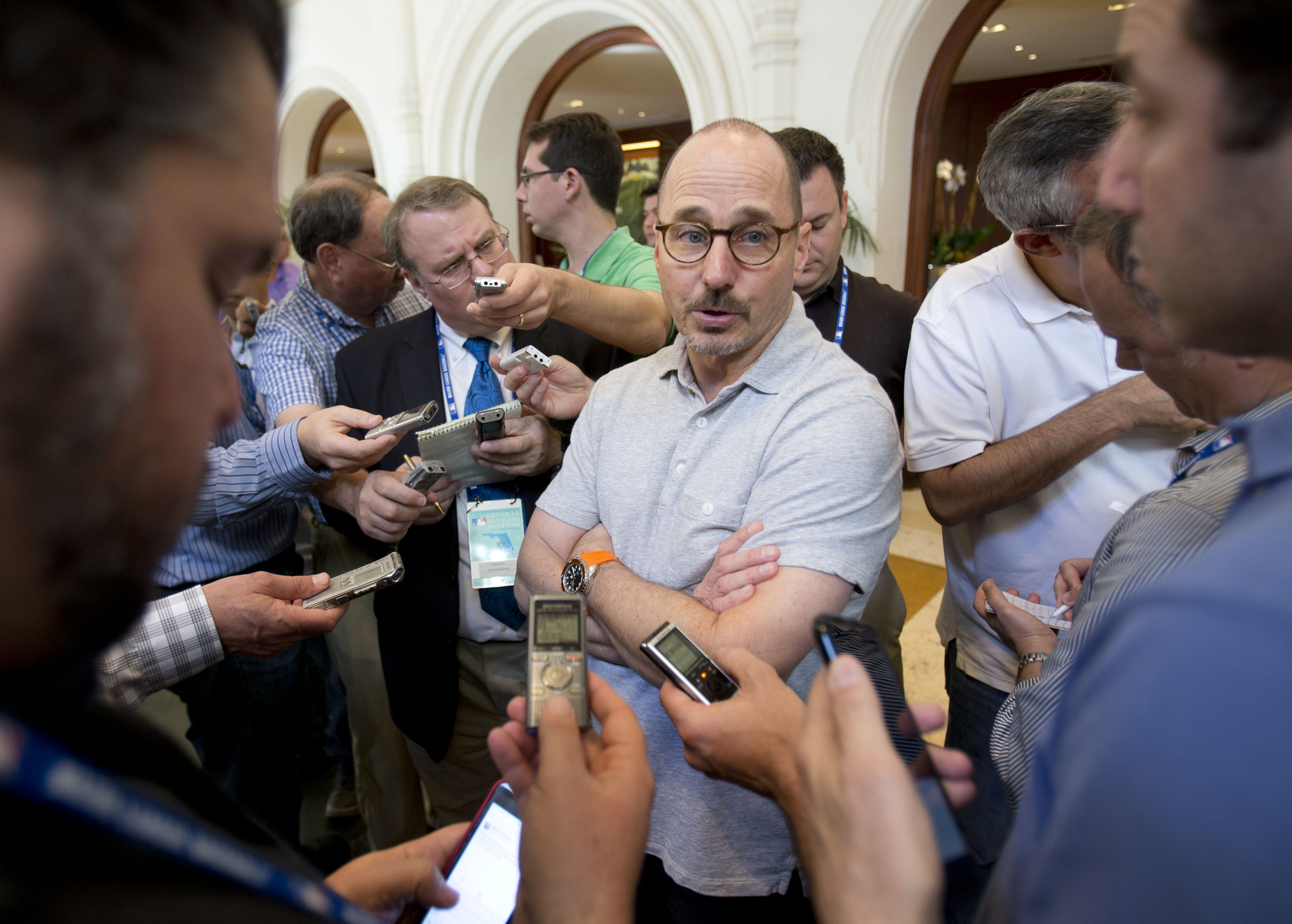 New York Yankees general manager Brian Cashman, center, speaks to member of the media as he attends the baseball general managers' meetings, Wednesday, Nov. 11, 2015, in Boca Raton, Fla. The Yankees have traded infielder Jose Pirela to the San Diego Padre
